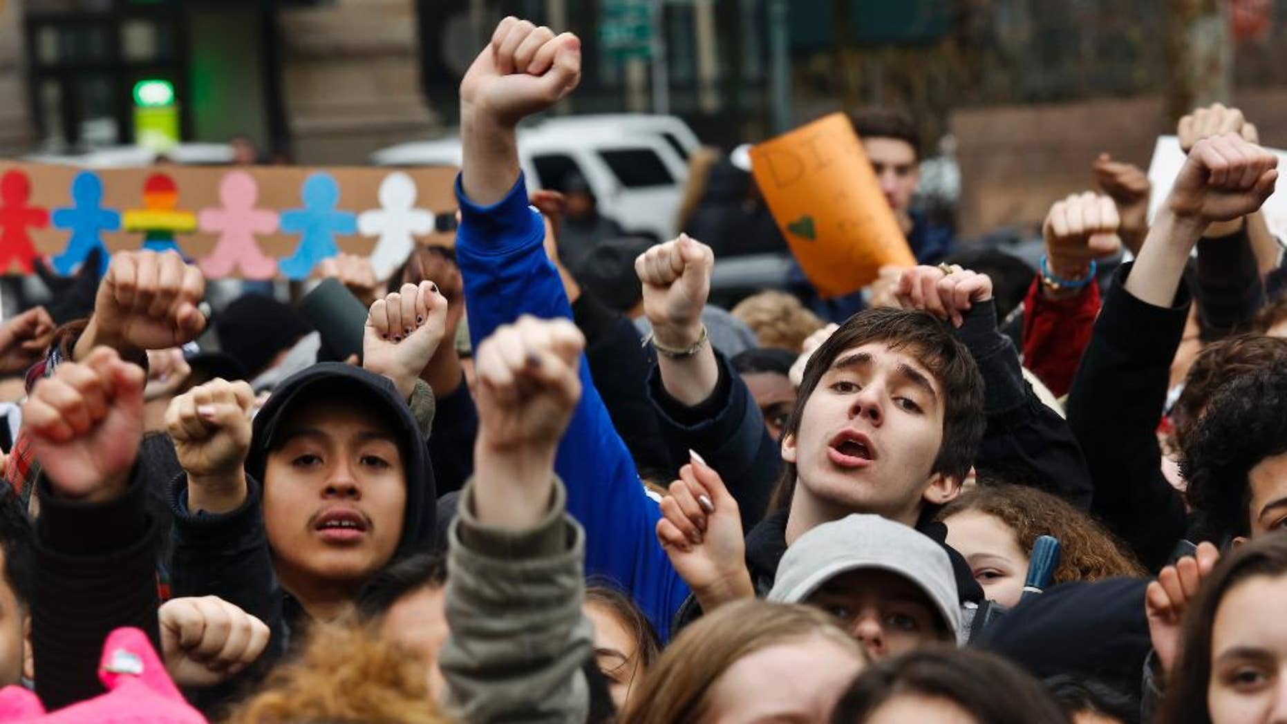 Students from high schools and colleges throughout New York city protest with clenched fists, during a rally against President Donald Trump's executive order banning travel from seven Muslim-majority nations, Tuesday Feb. 7, 2017, in New York's Foley Square. (AP Photo/Bebeto Matthews)
