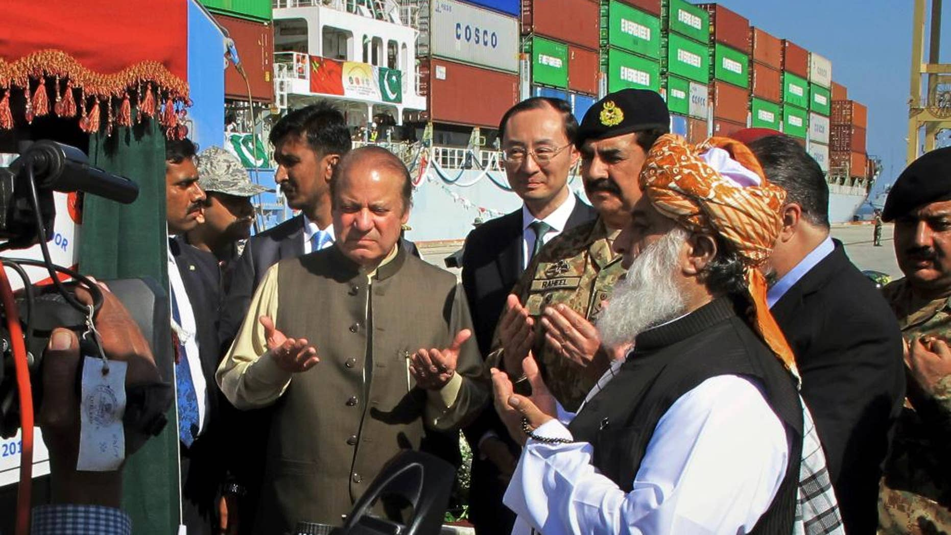Image result for Prime Minister Nawaz Sharif of Pakistan, center left, praying during the formal opening of Gwadar port in 2016. Credit Muhammad Yousuf/Associated Press