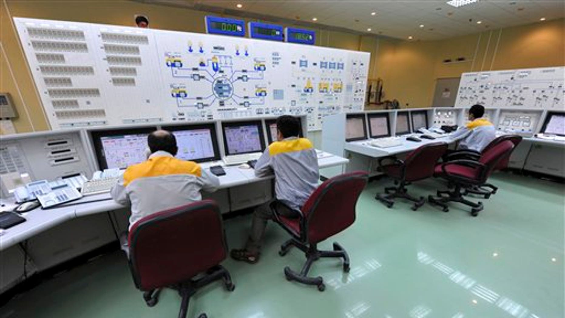Iranian technicians work at the Bushehr nuclear power plant, outside the southern Iranian city of Bushehr.