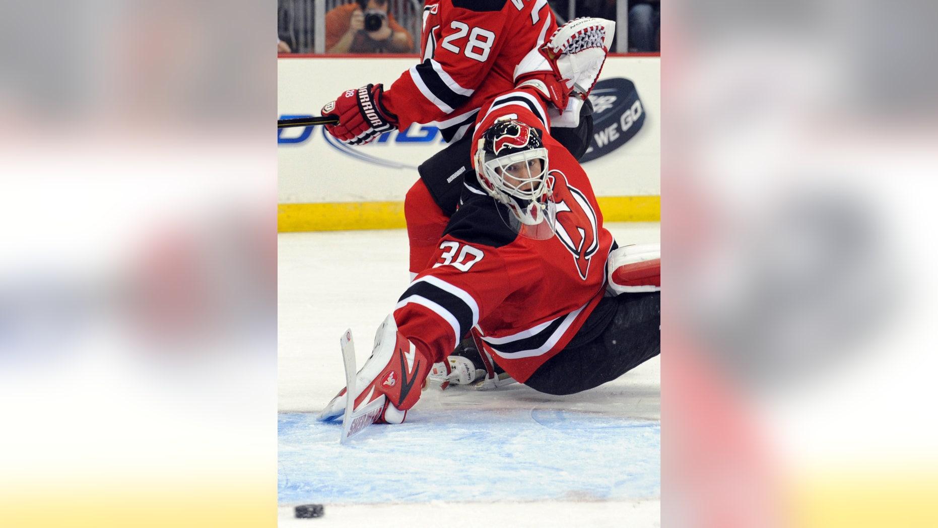 Goalie Martin Brodeur misses Devils' game against Jets, team