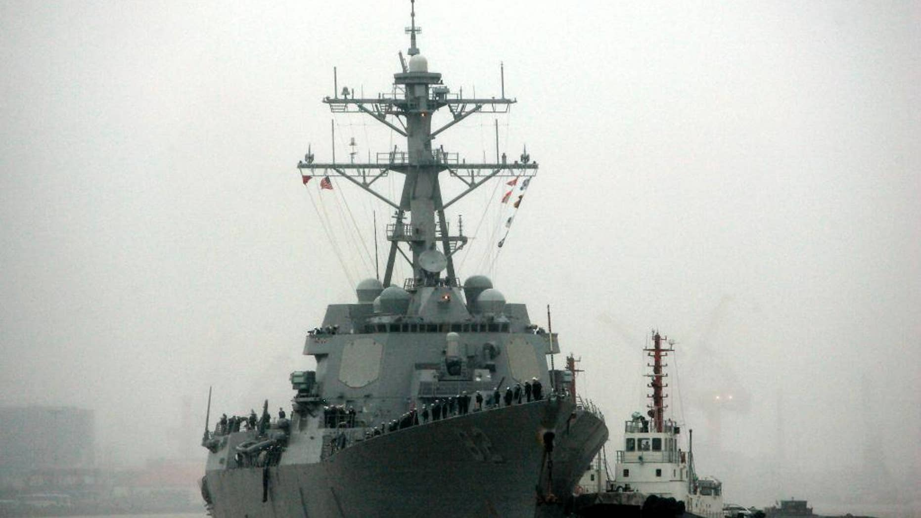 """In this April 8, 2008, file photo, guided missile destroyer USS Lassen arrives at the Shanghai International Passenger Quay in Shanghai, China, for a scheduled port visit. Just two days after the USS Lassen sailed past one of China's artificial islands in the South China Sea in a challenge to Chinese sovereignty claims, Defense Ministry spokesman Col. Yang Yujun said Thursday that China will take """"all necessary"""" measures in response to any future U.S. Navy incursions into what it considers its territorial waters around the islands. (AP Photo/Eugene Hoshiko, File)"""