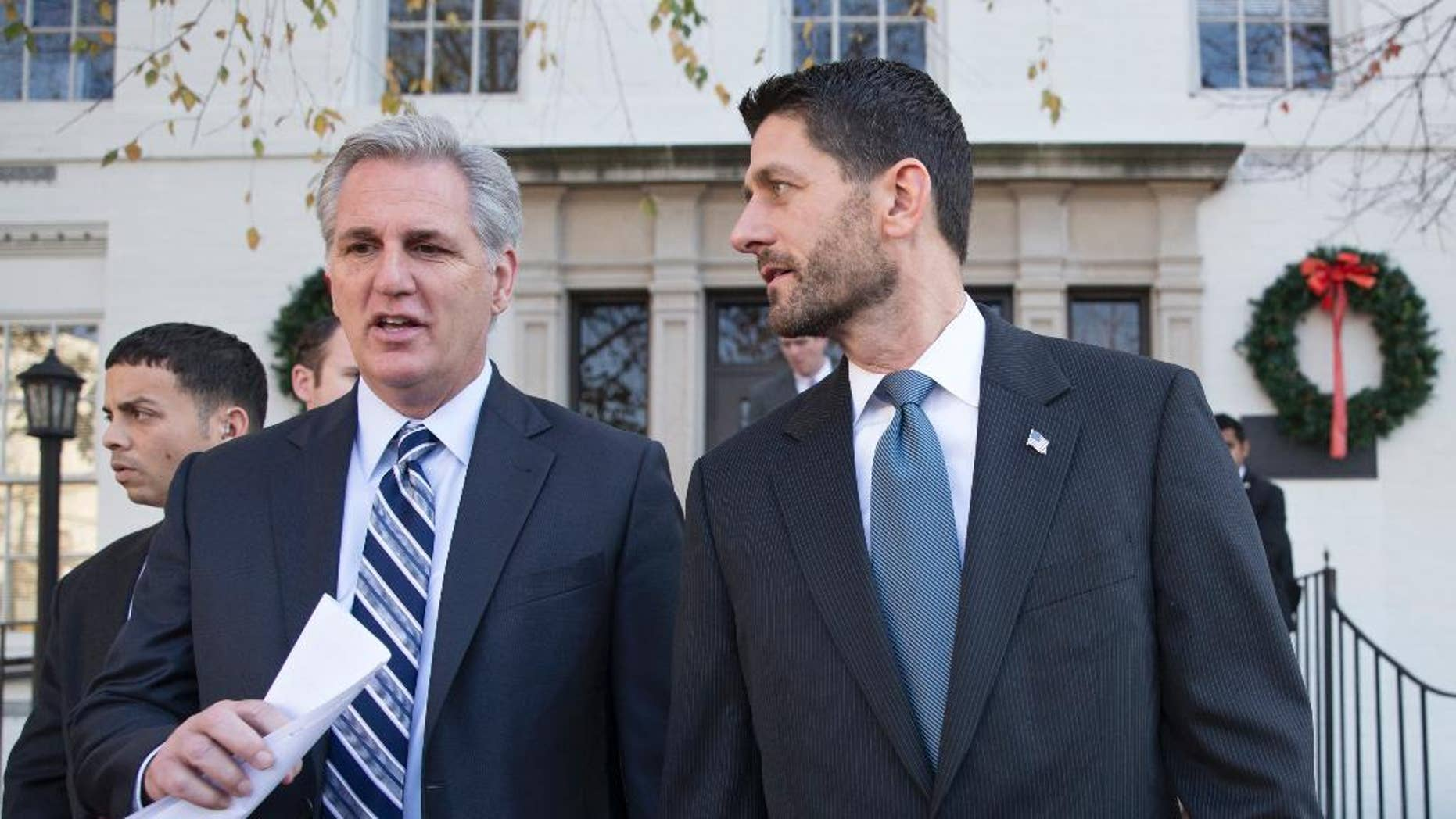 """Speaker of the House Paul Ryan, R-Wis., right, and Majority Leader Kevin McCarthy, R-Calif., leave a news conference following a GOP caucus meeting, at the Republican National Headquarters on Capitol Hill in Washington, Tuesday, Dec. 8, 2015. Ryan dismissed Republican presidential candidate Donald Trump's comments on Muslims, saying such views are """"not what this party stands for and more importantly it's not what this country stands for.""""  (AP Photo/J. Scott Applewhite)"""