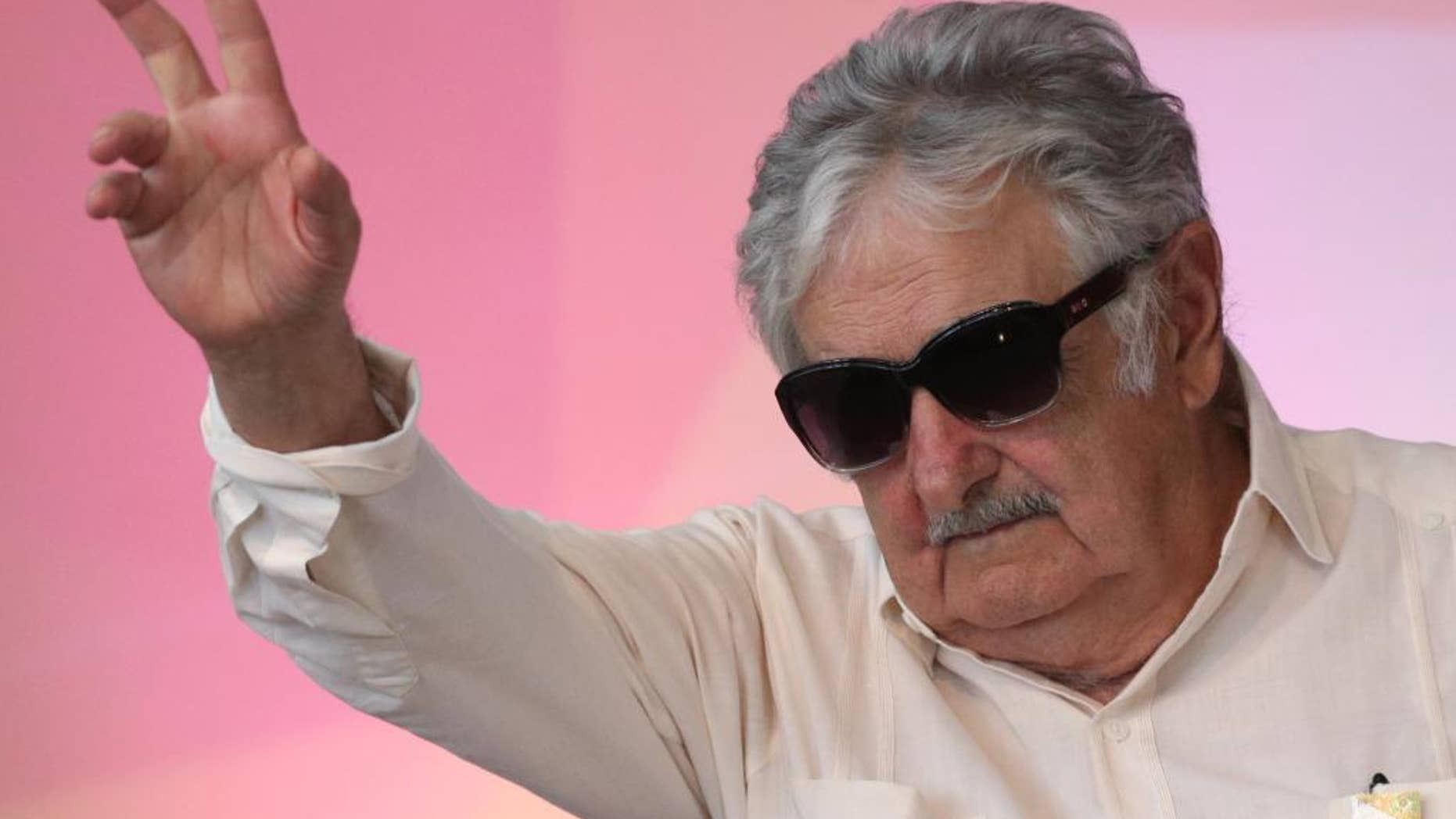 """FILE - In this Dec. 16, 2015 file photo, Uruguay's former President Jose Mujica waves to the crowd during the opening of the National Youth Conference, in Brasilia, Brazil. Mujica says Venezuelan President Nicolas Maduro is """"crazy as a goat,"""" while speaking Wednesday, May 18, 2016, at a press conference where he was asked about an escalating row between Maduro and the head of the Organization of American States. (AP Photo/Eraldo Peres, File)"""