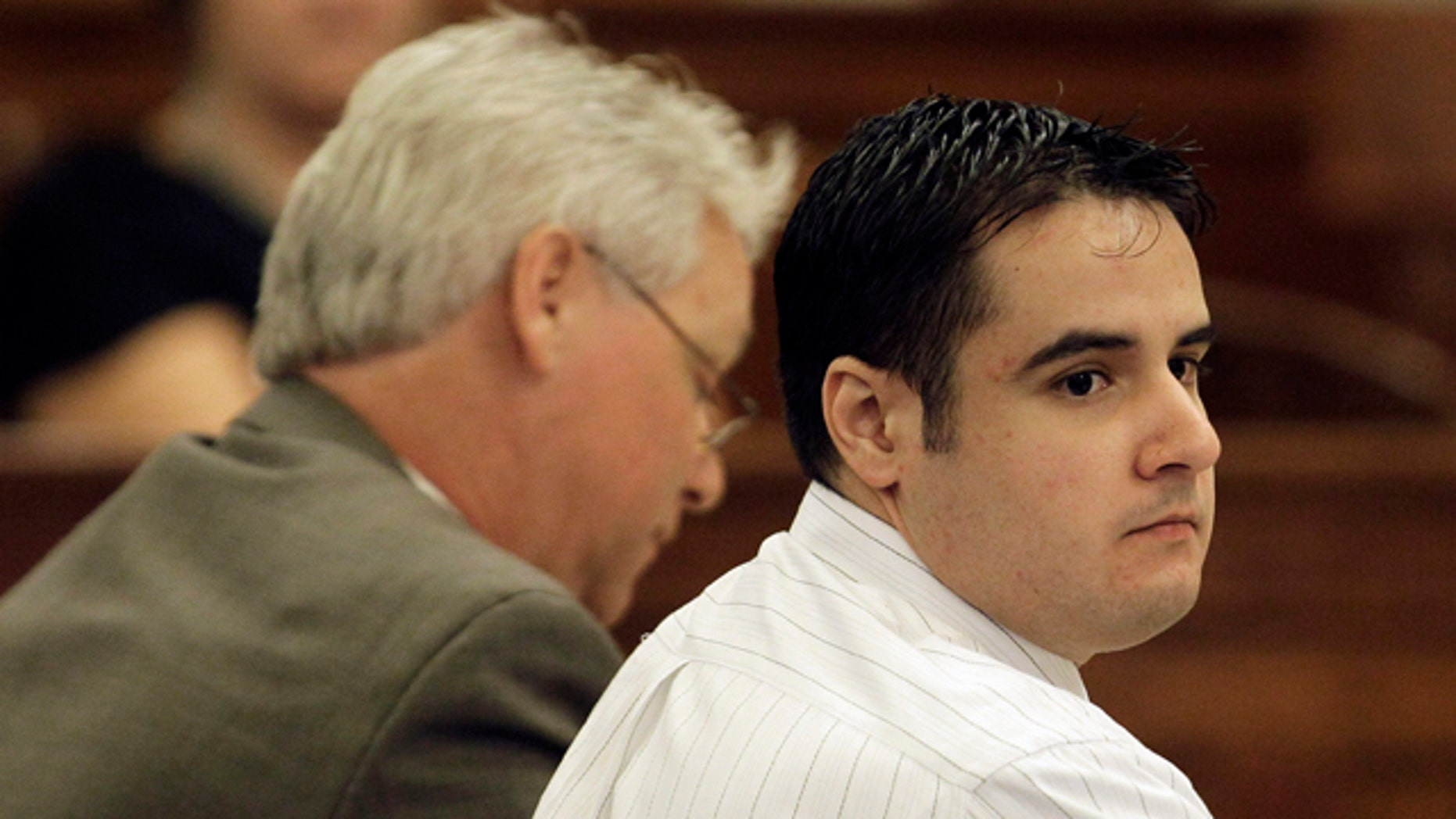 Aug. 13, 2010: Former Marine Cesar Laurean, right, listens during his trial at the Wayne County Courthouse in Goldsboro, N.C.