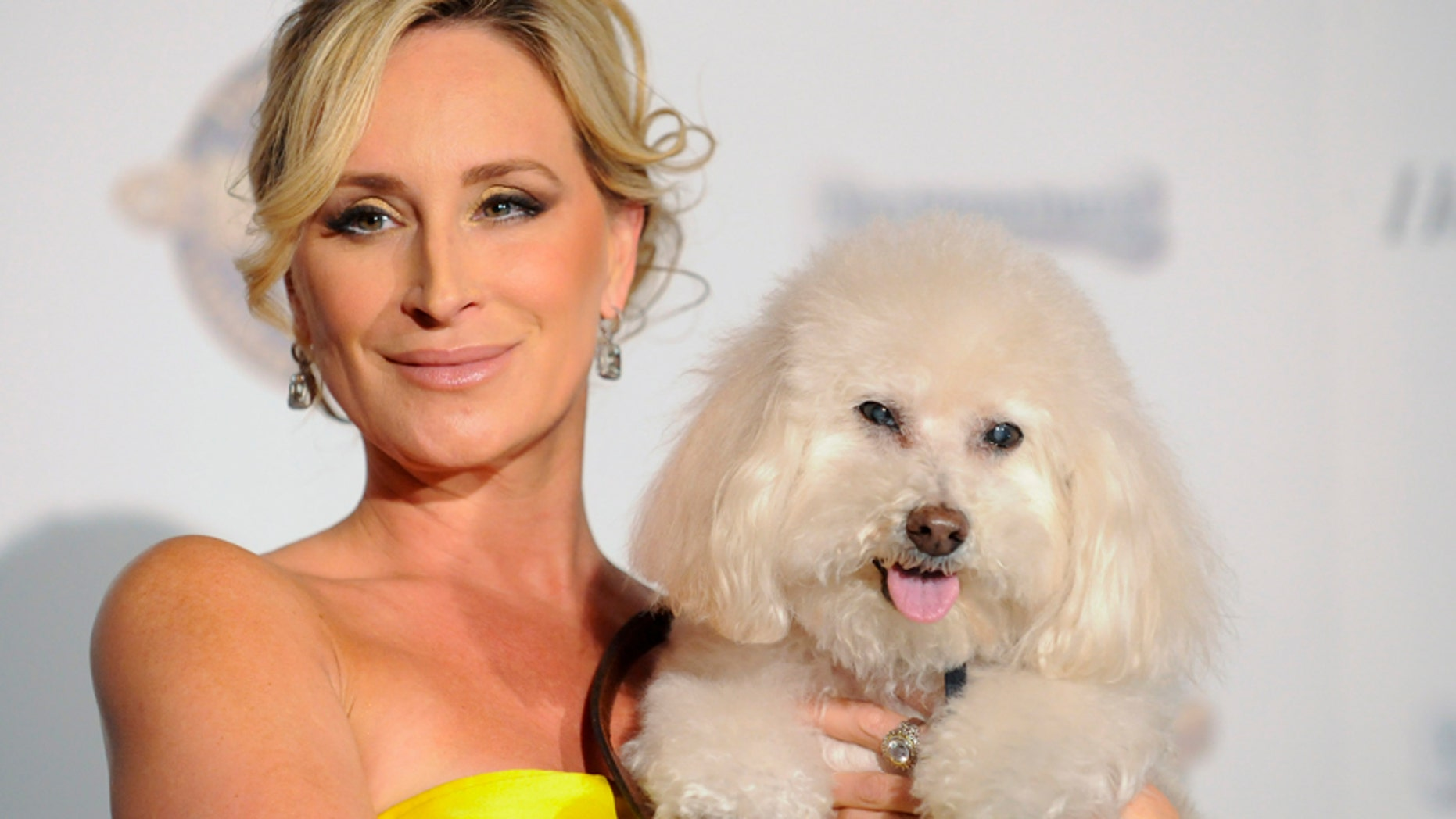 """""""Real Housewives of New York"""" star Sonja Morgan and her dog Millou arrive at the first annual Golden Collar Awards celebrating Hollywood's most talented canine thespians from Oscar nominated films and Emmy Award winning television shows in Los Angeles, California February 13, 2012."""