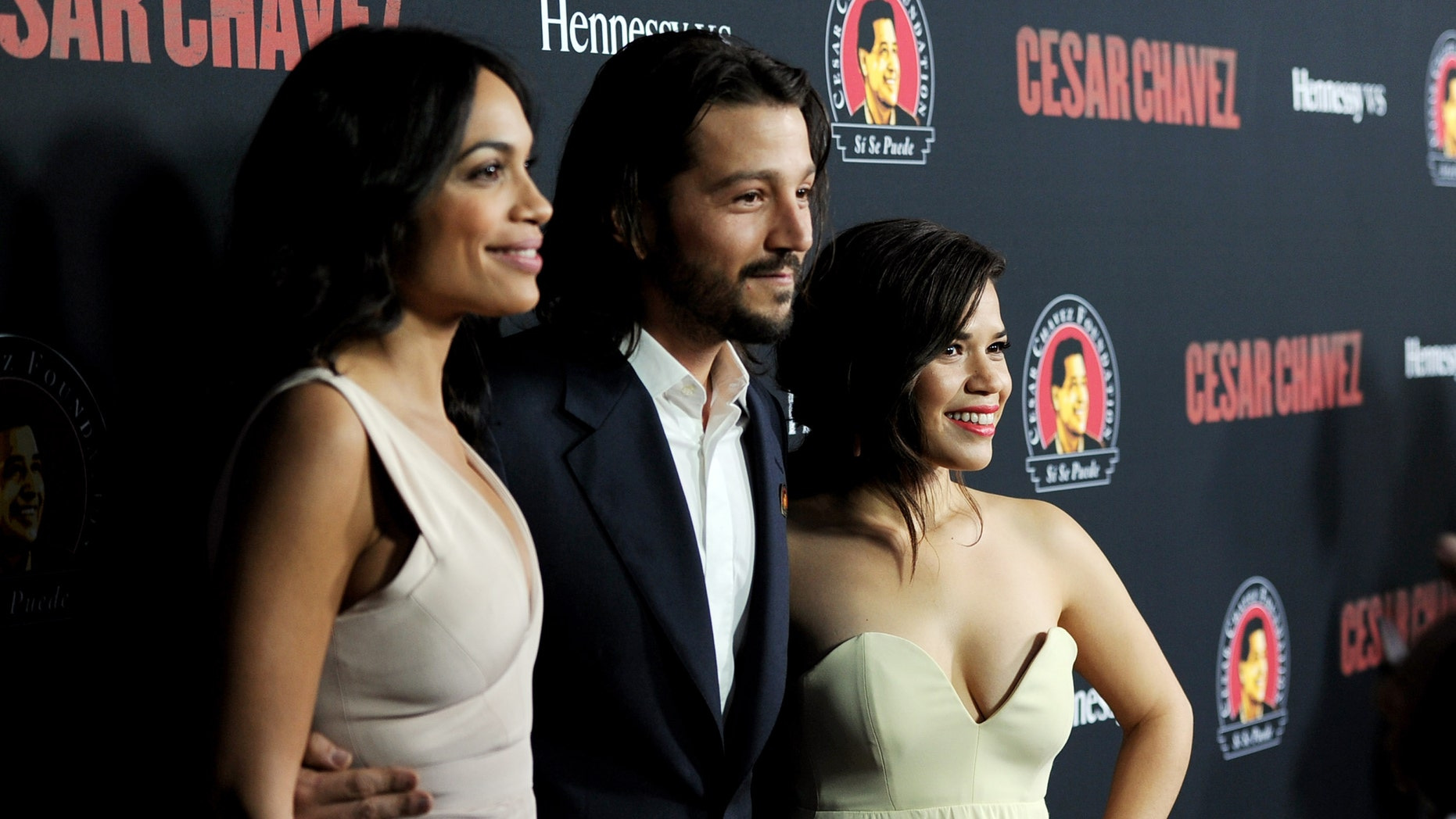 """LOS ANGELES, CA - MARCH 20:  (L-R) Actress Rosario Dawson, director Diego Luna and actress America Ferrera arrive at the premiere of Pantelion Films And Participant Media's """"Cesar Chavez"""" at the Chinese Theatre on March 20, 2014 in Los Angeles, California.  (Photo by Kevin Winter/Getty Images)"""