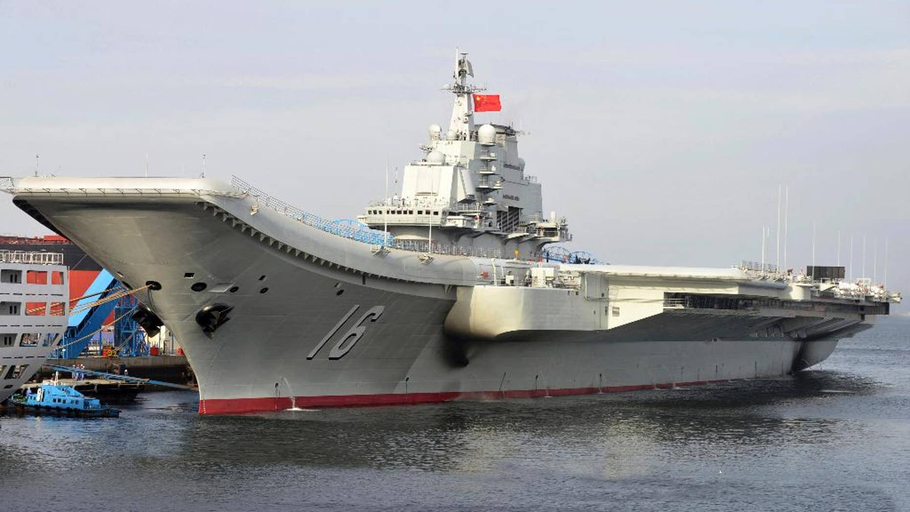 FILE - In this undated file photo released by China's Xinhua News Agency, China's aircraft carrier Liaoning berths in a port of China. China's military says its first aircraft carrier group has carried out a series of fighter launch, recovery and air combat exercises in the Yellow Sea amid tensions with the U.S. and Taiwan. The Defense Ministry announced late Friday that the Liaoning carrier group conducted the drills in the Yellow Sea in recent days and is scheduled to continue exercises farther afield. (AP Photo/Xinhua, Li Tang, File)
