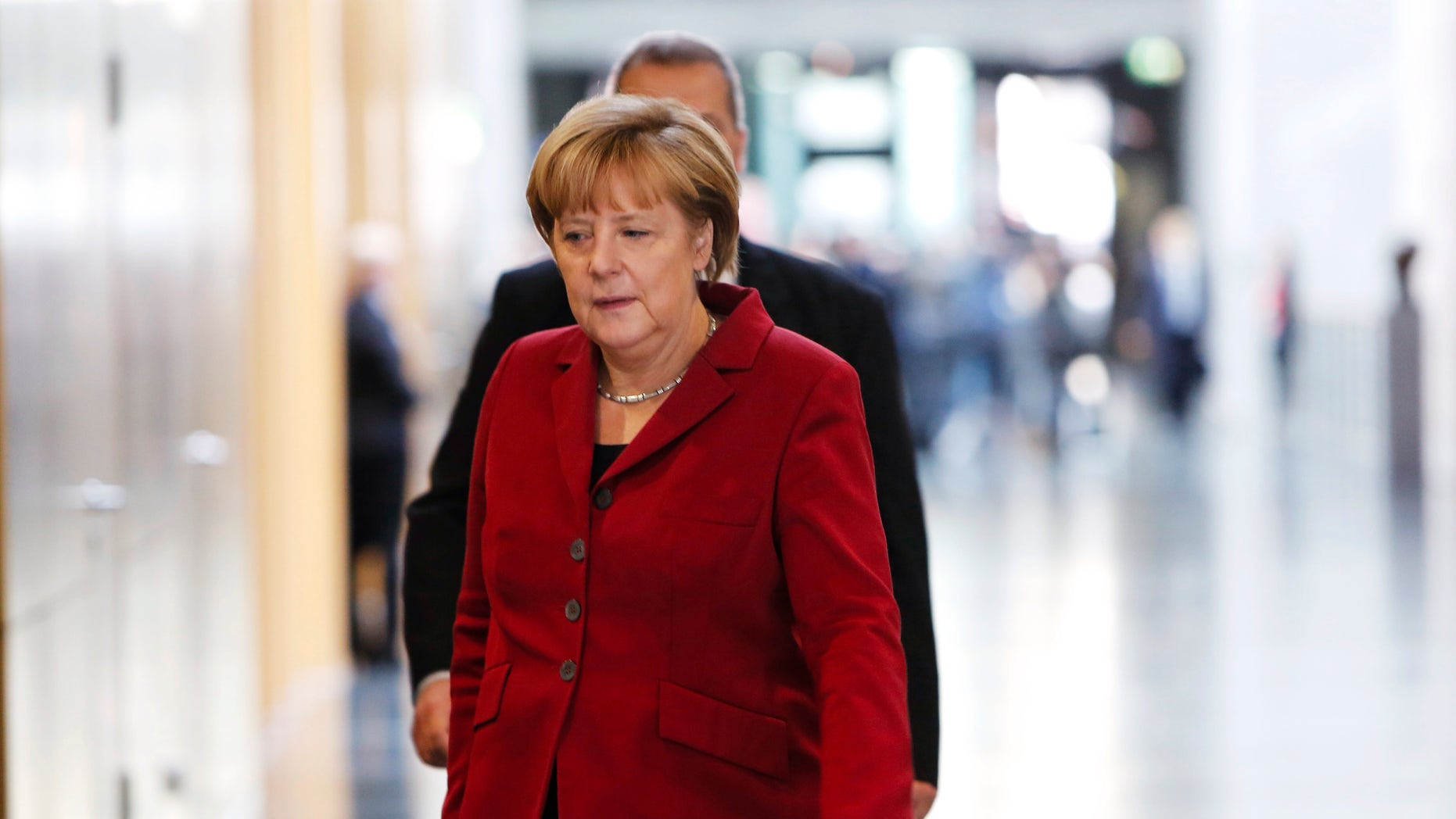 German Chancellor and chairwoman of the Christian Democrats, CDU, Angela Merkel arrives for a meeting with the Christian parties delegation prior to exploratory talks on a coalition with the Social Democratic Party, SPD, in Berlin, Germany, Thursday, Oct. 17, 2013. Following the national elections on Sept. 22, 2013, Merkel is still in negotiations for a coalition partner for her third term. (AP Photo/Markus Schreiber)