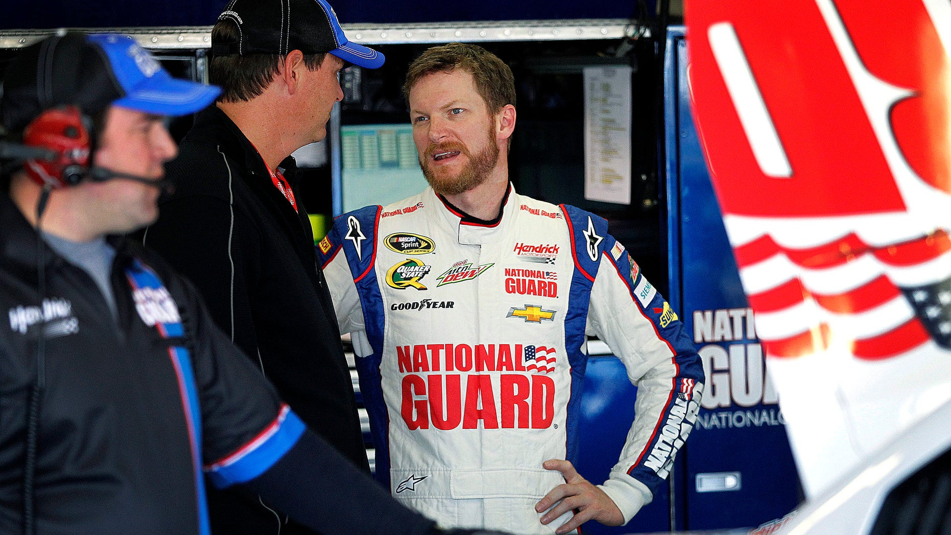 Dale Earnhardt Jr., talks with his team during testing at Texas Motor Speedway, Thursday, April 11, 2013, in Fort Worth,Texas. The NASCAR Sprint Cup Series NRA 500 auto race is scheduled to run Saturday, April 13. (AP Photo/The Fort Worth Star-Telegram, Ron Jenkins)  MAGS OUT; (FORT WORTH WEEKLY, 360 WEST); INTERNET OUT