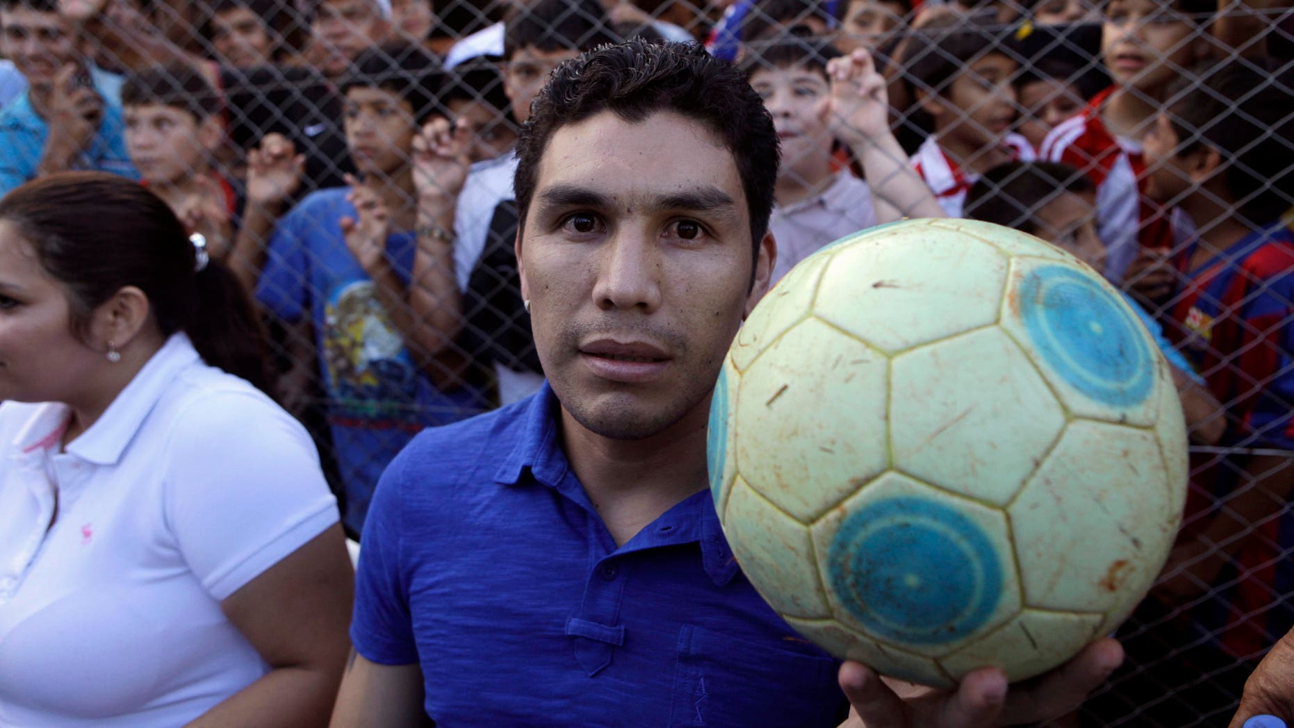 Former player of Mexico's America soccer team Salvador Cabanas, from Paraguay, poses for a picture during a friendly game by the first team he played in, 12 de Octubre, in Itagua, Paraguay, Thursday Dec. 30, 2010.  Cabanas, 30, was shot in the head at point-blank range 11 months ago in a Mexico City bar. He survived the attack but is not expected to play again. (AP Photo/Jorge Saenz)