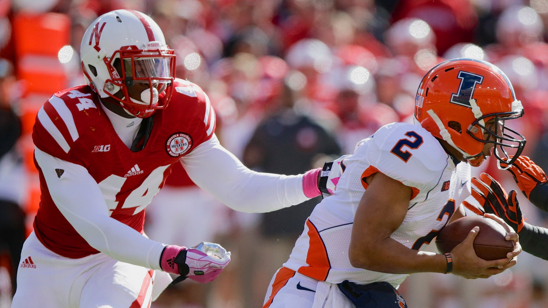FILE - In this Oct. 5, 2013, file photo, Illinois quarterback Nathan Scheelhaase (2) is pursued and later sacked by Nebraska defensive end Randy Gregory (44) during the first half of an NCAA college football game in Lincoln, Neb. This week's game at Purdue game might not move the excitement meter for Nebraska fans. To Gregory, it's a red-letter game. He started junior college two years ago thinking he eventually would wind up at Purdue. Instead, he landed up at Nebraska. (AP Photo/Nati Harnik, File)