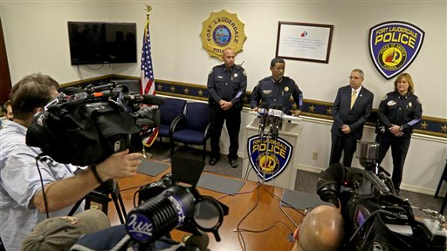 Fort Lauderdale Police Chief Frank Adderly addresses the media on Tuesday, Feb. 24, 2015.