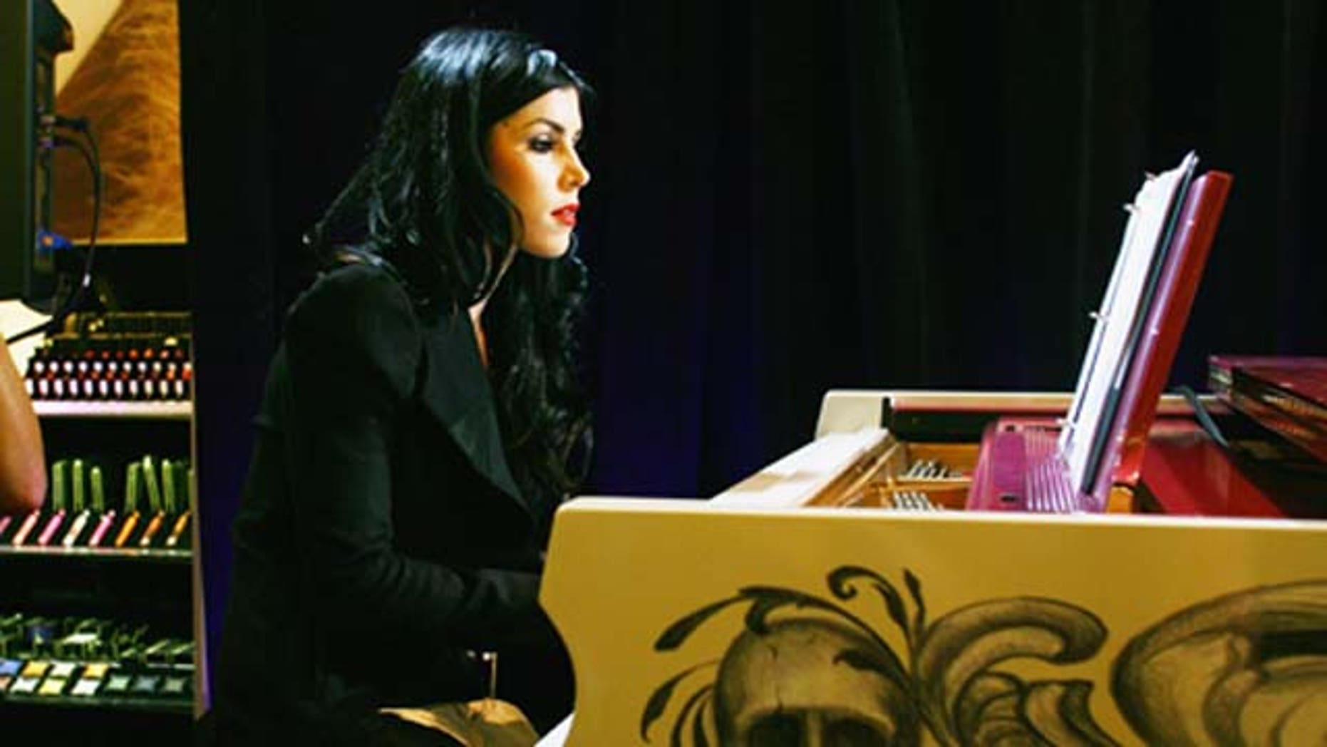 Sept. 8, 2011: Tattoo artist and TV star Kat Von D entertains the guests by playing the piano during Sephora Times Square & Sephora 5 Times Square Fashion's Night Out at Sephora Times Square in New York City.