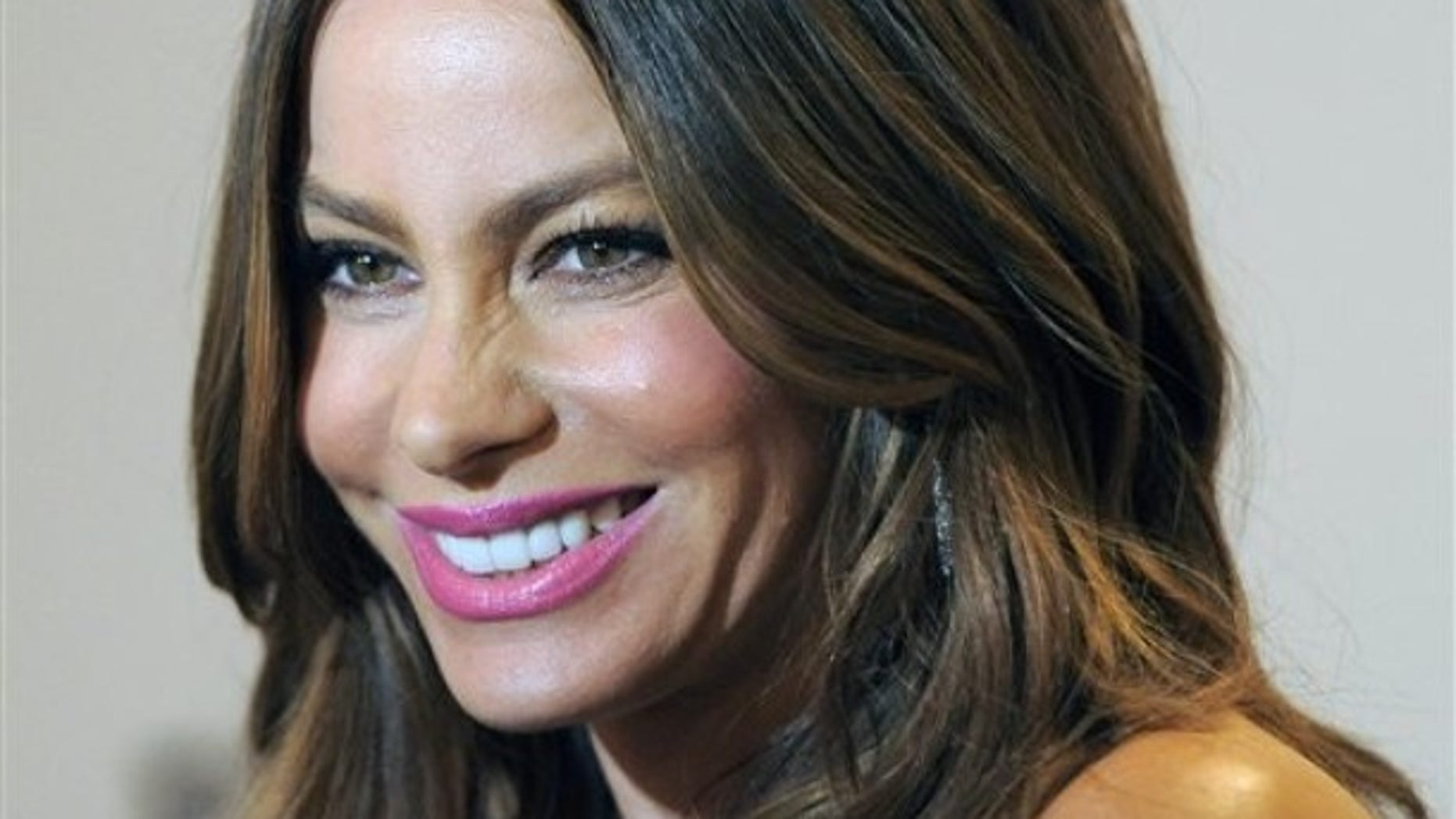 """Sofia Vergara, a cast member in the television series """"Modern Family,"""" poses before the PaleyFest 2012 panel discussion on the show, Wednesday, March 14, 2012, in Beverly Hills, Calif. (AP Photo/Chris Pizzello)"""