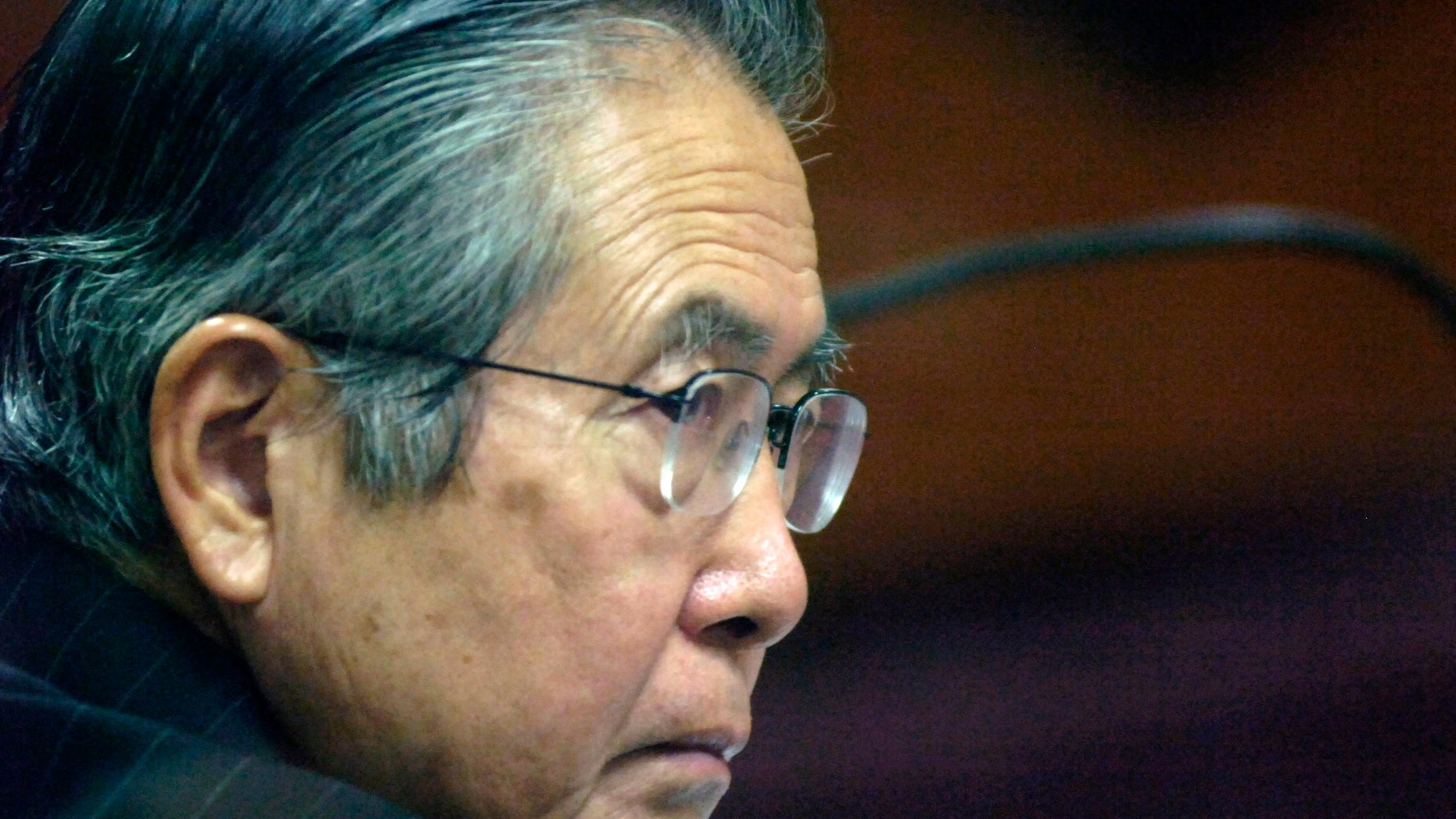 FILE - In this Jan. 23, 2008 file photo, Peru's former President Alberto Fujimori attends a session of his trial at a police base in Lima, Peru. Incarcerated for authorizing death squads and corruption, the former leader is not permitted to give interviews or make public statements. Yet he has 10,000 Twitter followers three weeks after opening an account, and he's used YouTube three times to make short audio statements, setting off a media sensation in Peru as he rallies supporters and trades barbs with political foes. (AP Photo/Karel Navarro, File)