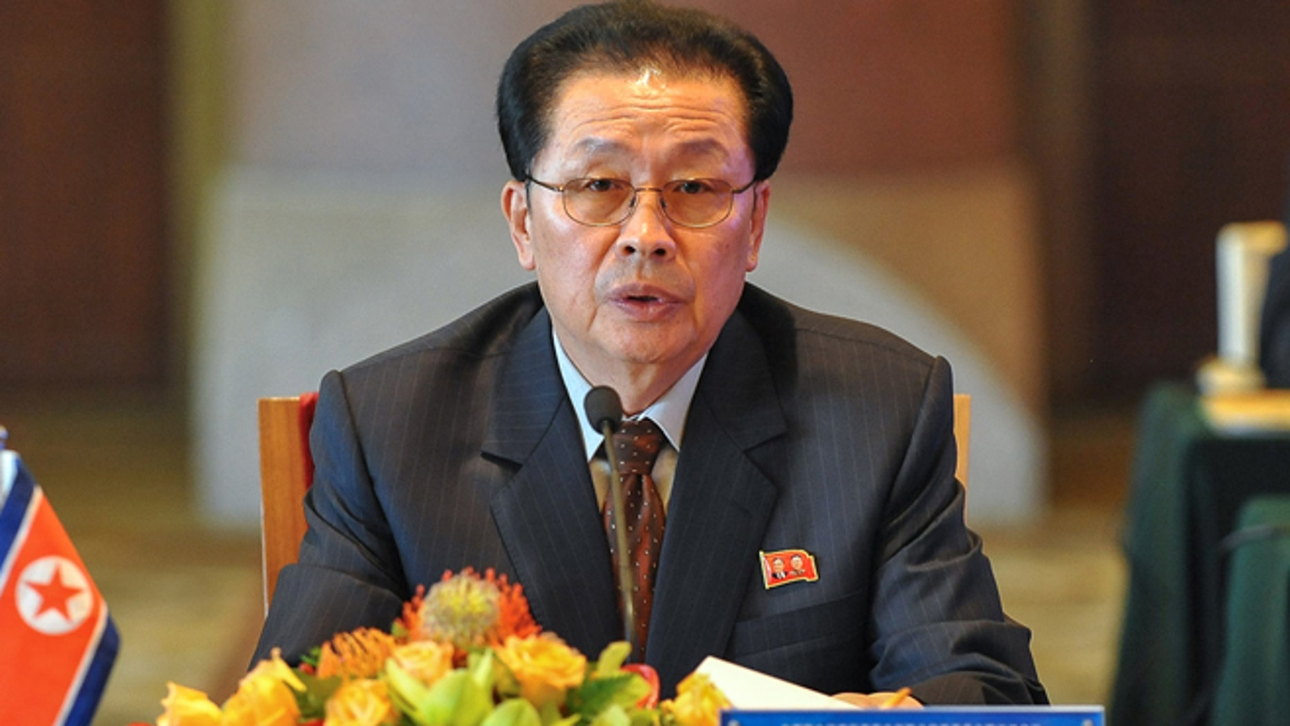 Aug. 14, 2012: In this file photo provided by China's Xinhua News Agency, Jang Song Thaek, North Korea's vice chairman of the powerful National Defense Commission, attends the third meeting on developing the economic zones in North Korea, in Beijing.