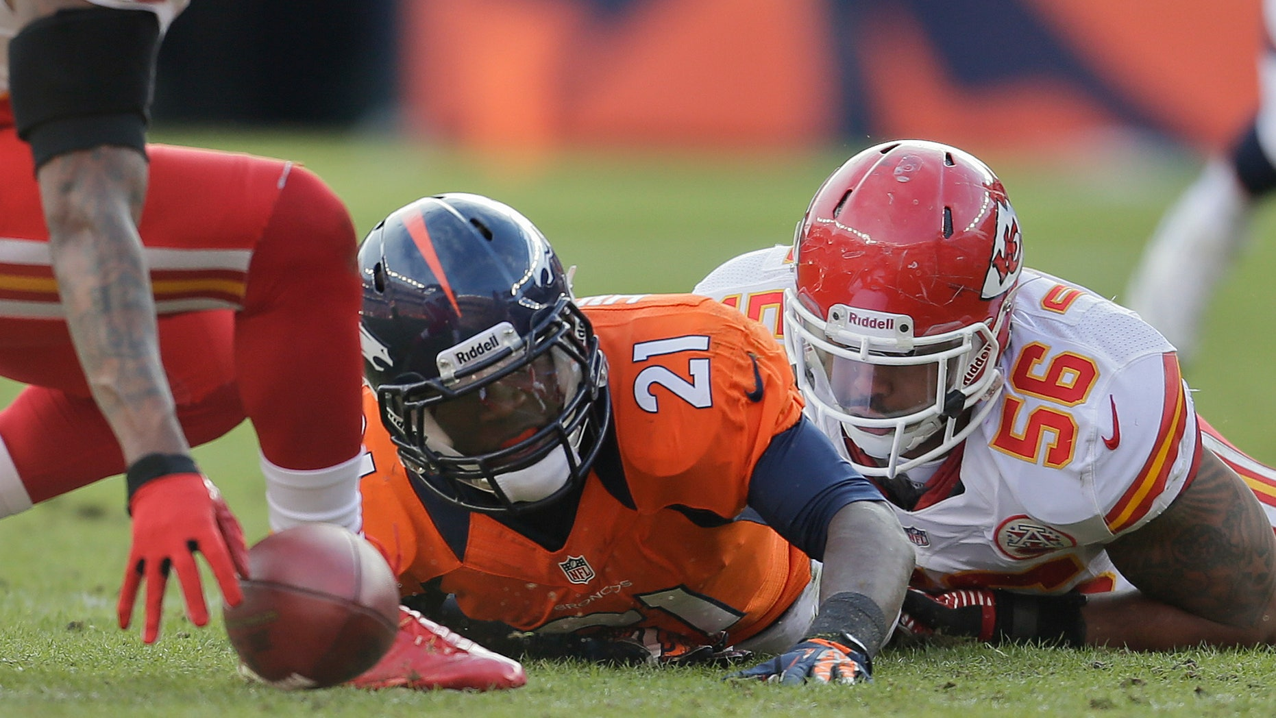Denver Broncos running back Ronnie Hillman (21) fumbles the ball as he is tackled by Kansas City Chiefs inside linebacker Derrick Johnson (56) in the first quarter of an NFL football game, Sunday, Dec. 30, 2012, in Denver. Kansas City recovered the ball on the play.  (AP Photo/Joe Mahoney)