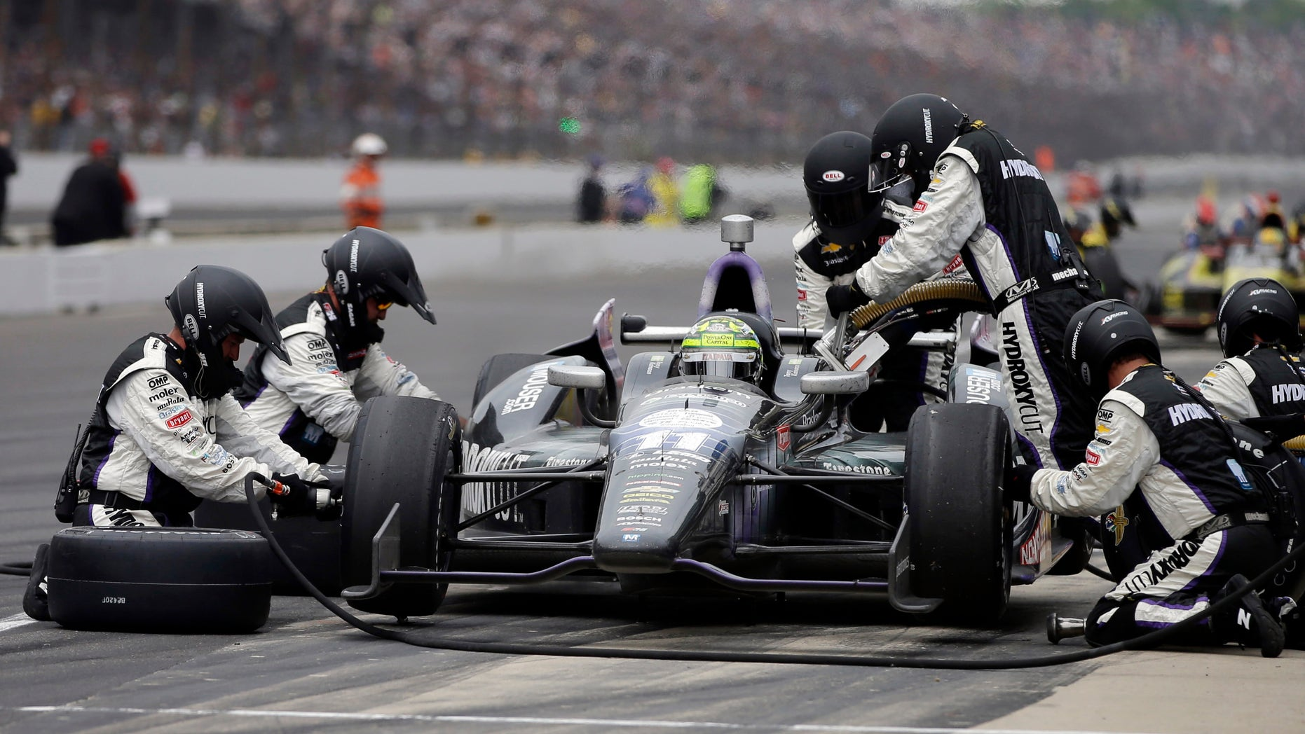Tony Kanaan, of Brazil, makes a pit stop during the Indianapolis 500 auto race at the Indianapolis Motor Speedway in Indianapolis Sunday, May 26, 2013. (AP Photo/Darron Cummings)
