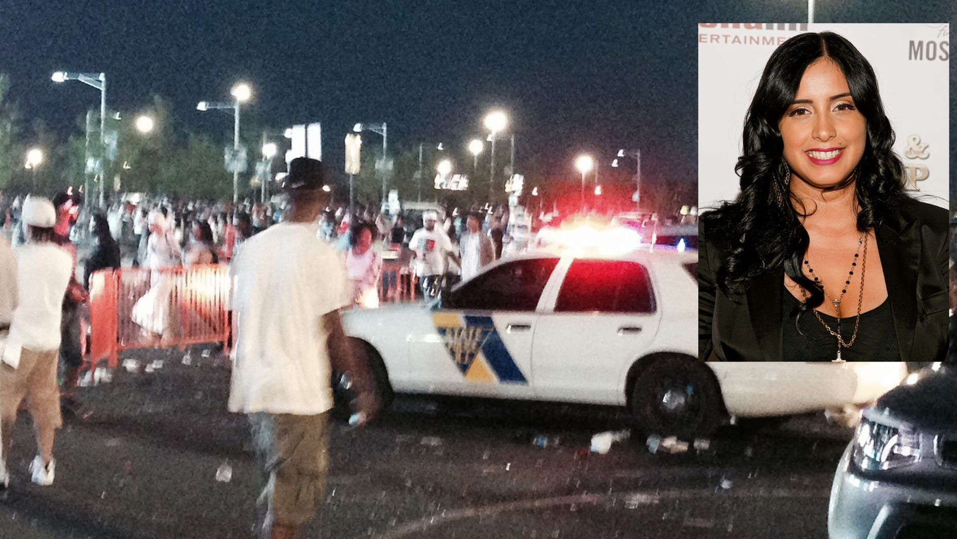 Fans at the Hot 97 Summer Jam concert confront police officers outside the MetLife Stadium in East Rutherford, N.J., Sunday, June 7, 2015. Crowds on Sunday night became upset when the gates were closed and blocked off by police in riot gear, the Asbury Park Press reported. (Chris Jordan/The Asbury Park Press via AP)  NO SALES