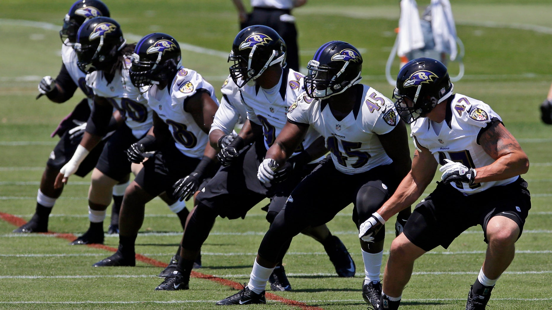 A group of Baltimore Ravens linebackers run a drill during NFL football practice at the team's training facility in Owings Mills, Md., Friday, May 31, 2013. (AP Photo/Patrick Semansky)