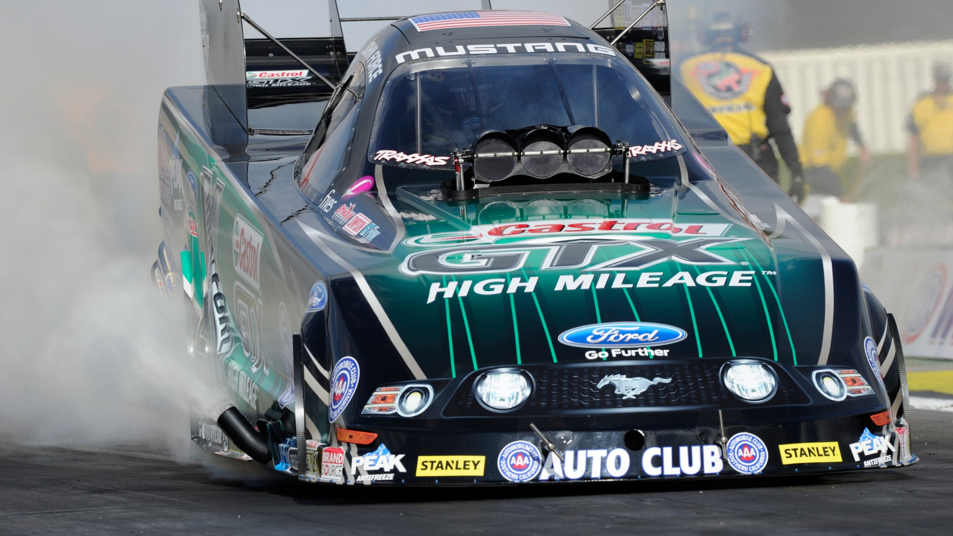 In this photo provided by NHRA, John Force takes part in Funny Car qualifying Friday, Feb. 7, 2014, in Pomona, Calif., for the NHRA Winternationals. Forced topped the field with a time of 3.966 seconds at 324.12 mph. (AP Photo/NHRA, Marc Gewertz)