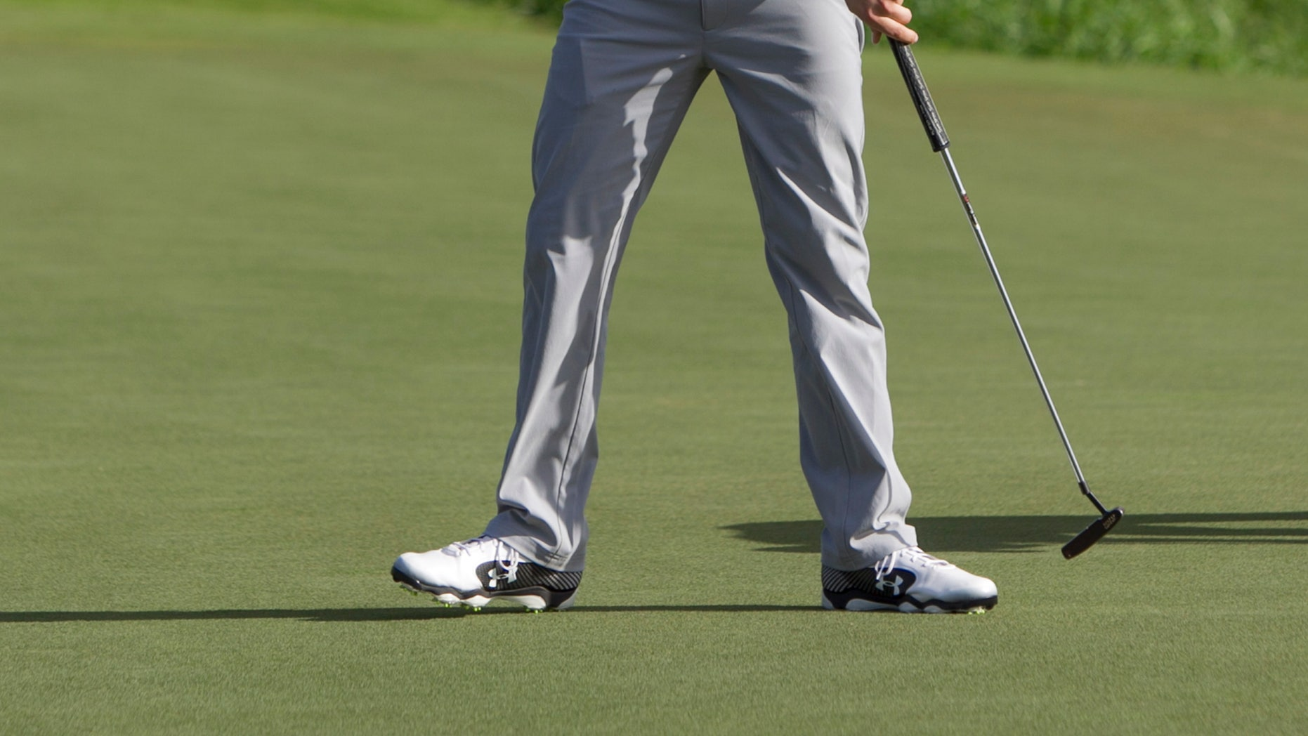 Jordan Spieth reacts to his putt at the end of his final round of the Tournament of Champions golf tournament, Monday, Jan. 6, 2014, in Kapalua, Hawaii.  (AP Photo/Marco Garcia)