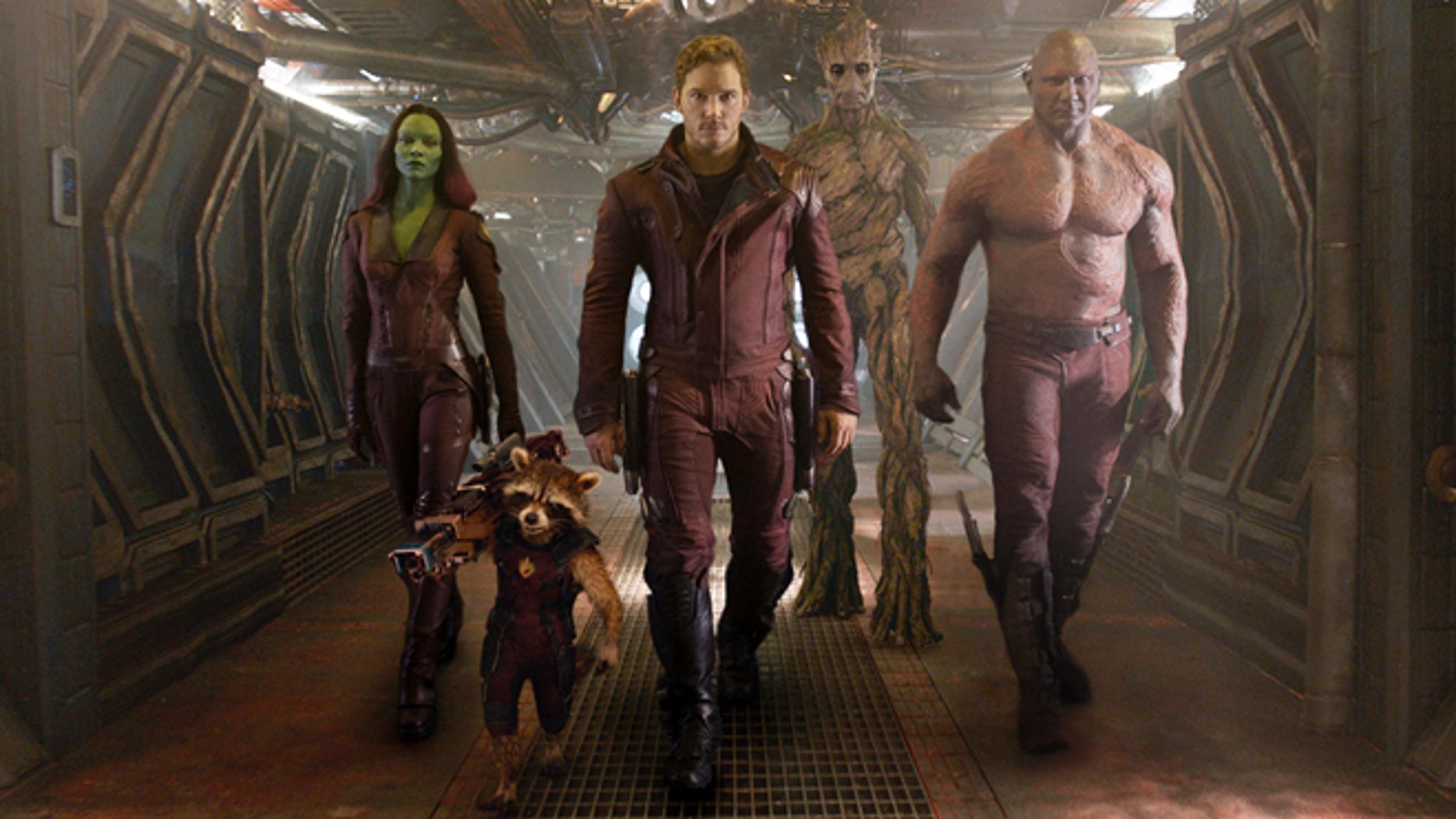 """This image released by Disney - Marvel shows, from left, Zoe Saldana, the character Rocket Racoon, voiced by Bradley Cooper, Chris Pratt, the character Groot, voiced by Vin Diesel and Dave Bautista in a scene from """"Guardians of the Galaxy."""" (AP Photo/Disney - Marvel)"""