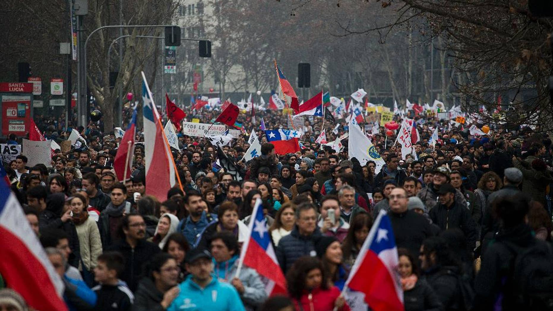 Thousands of workers march against the Pension Fund Administrators demanding an end to the system due to low pensions, in Santiago, Chile, Sunday, July 24, 2016. There were demonstrations and marches in several other cities in the conuntry. (AP Photo/Esteban Felix)