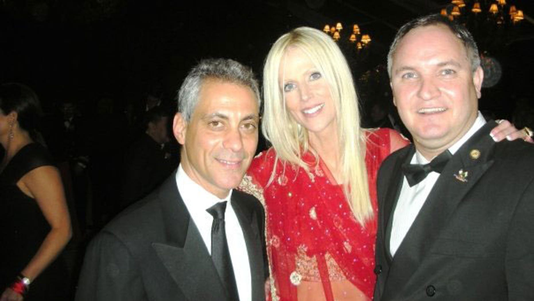 The Salahis photographed with White House chief of staff Rahm Emanuel at last week's state dinner.