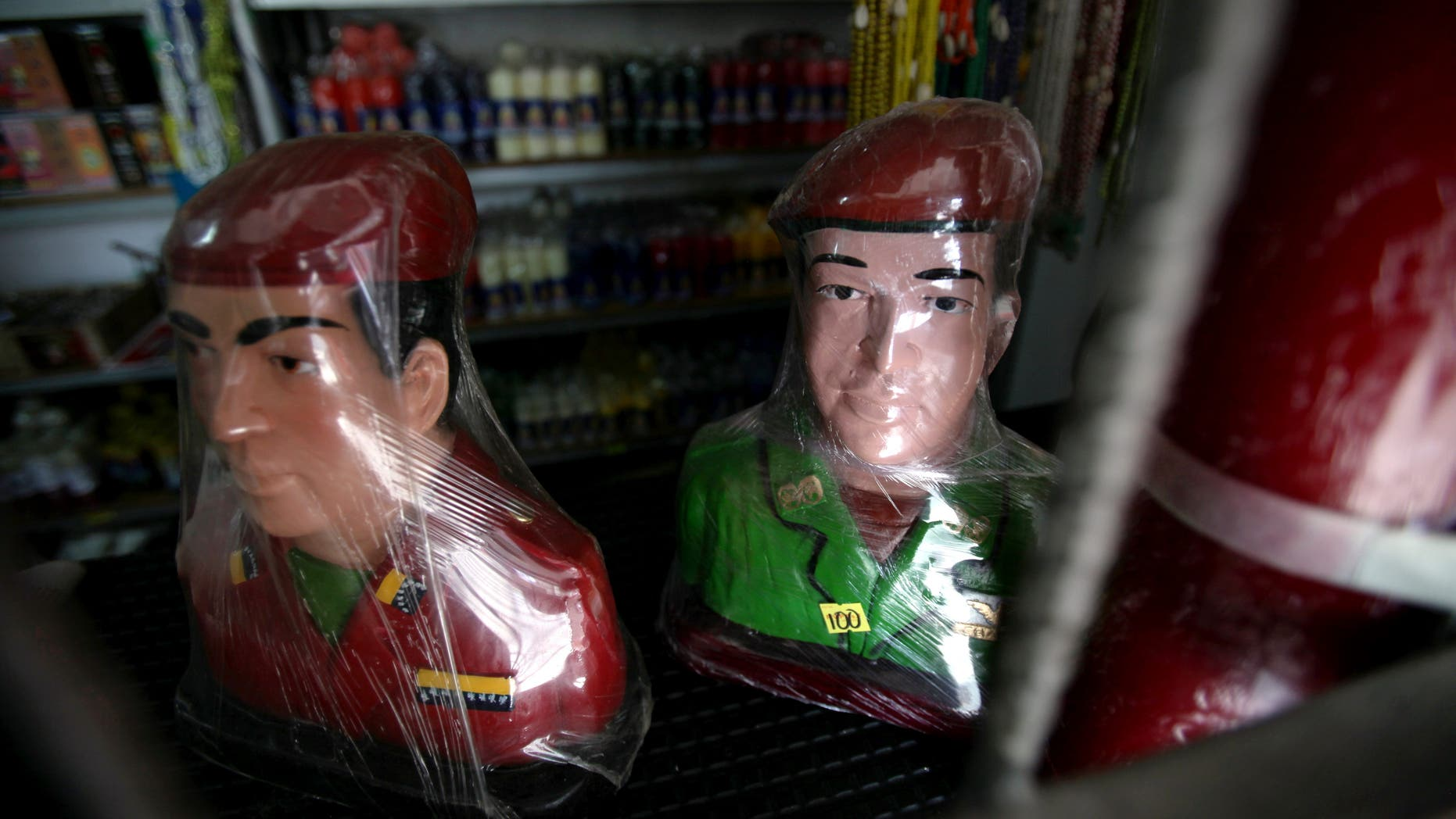 Plastic wrapped busts of Venezuela's late President Hugo Chavez sit for sale at a market in Moron, Venezuela, Thursday, April 25, 2013.  Venezuelan opposition leader Henrique Capriles said Thursday the opposition would go to the Supreme Court to challenge the results of the April 14 presidential vote, which was narrowly won by Chavez's political heir, Nicolas Maduro.  (AP Photo/Fernando Llano)