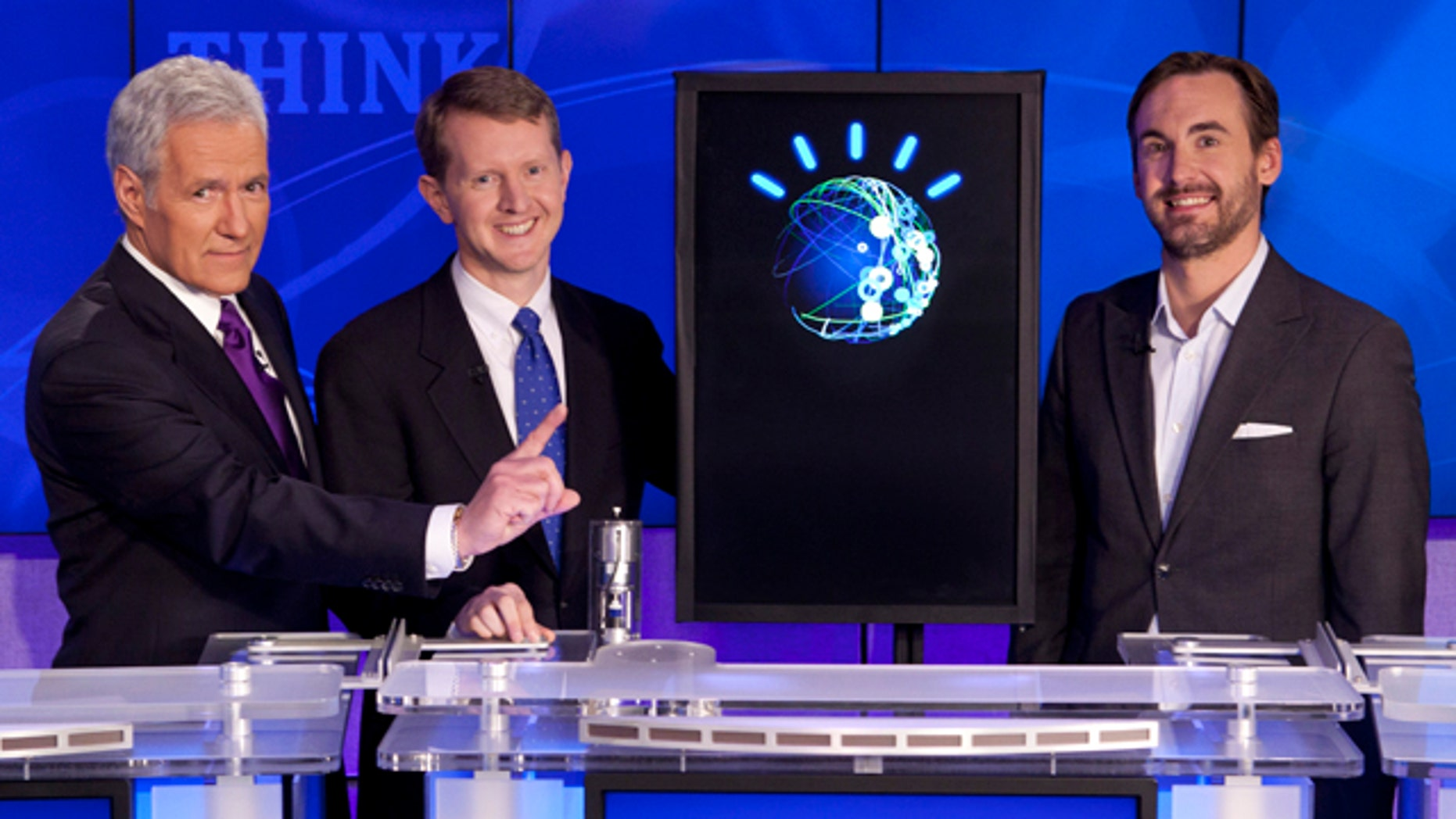 In this undated publicity image released by Jeopardy Productions, Inc., host Alex Trebek, left, poses with contestants Ken Jennings, center, and Brad Rutter and a computer named Watson in Yorktown Heights, N.Y.