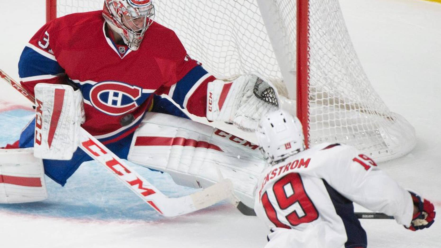 Montreal Canadiens goaltender Carey Price (31) makes a save against Washington Capitals Nicklas Backstrom during the third period of an NHL hockey preseason game Sunday, Sept. 28, 2014, in Montreal. (AP Photo/Graham Hughes)