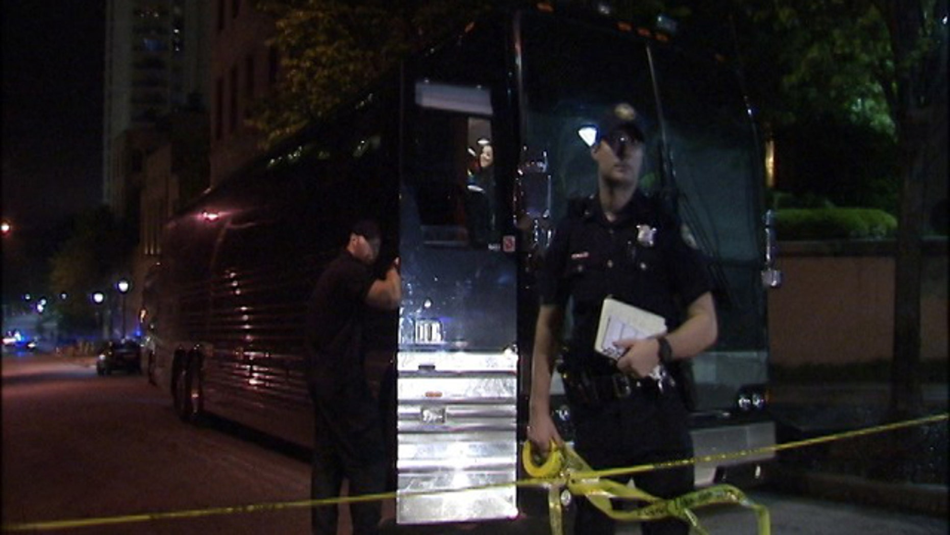 April 26, 2015: Atlanta police rope off one of two buses that was struck by gunfire early Sunday. Rapper Lil Wayne was unhurt after someone opened fire on his tour bus following a performance at an Atlanta night club. (MyFoxAtlanta.com)