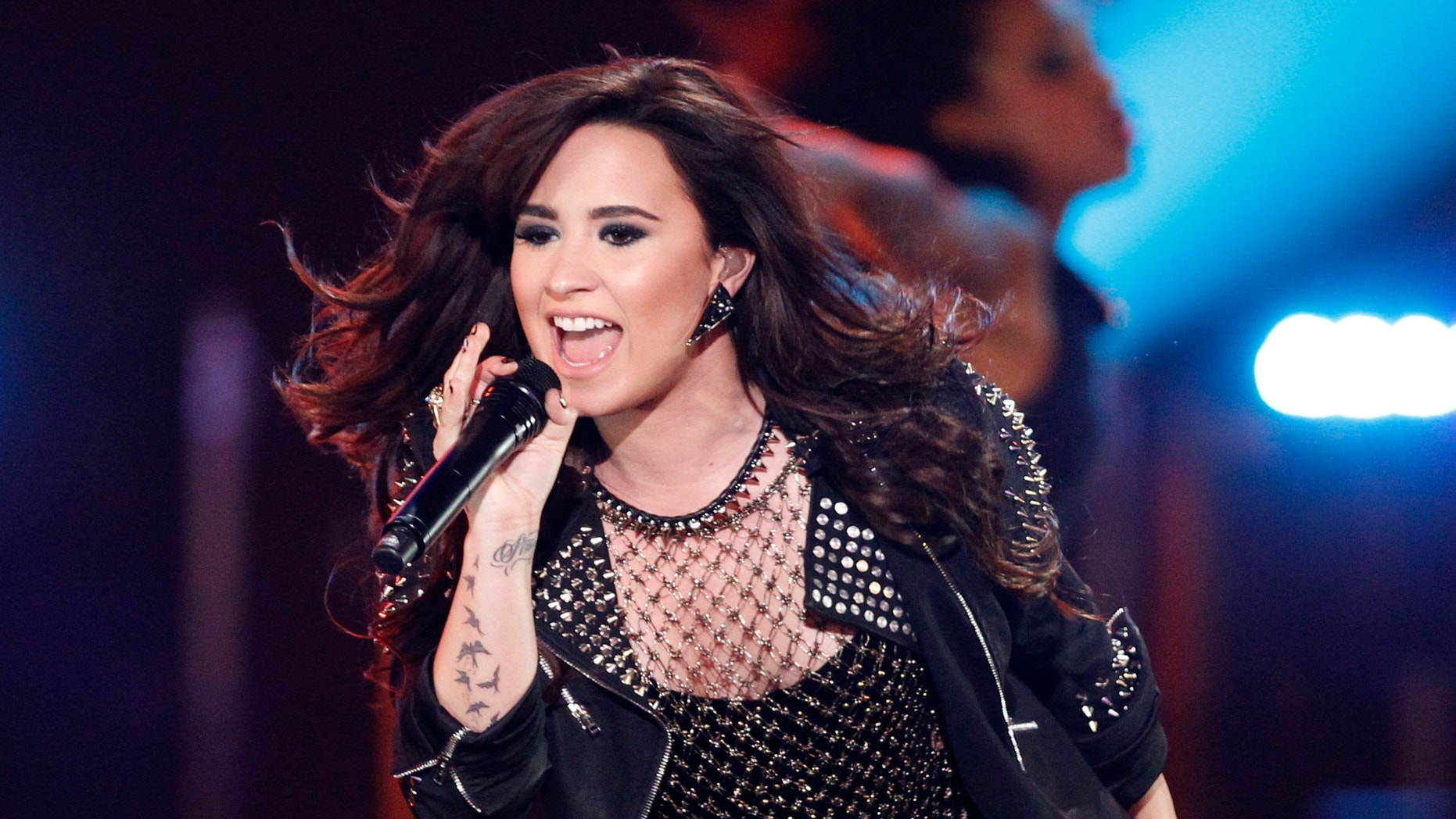 """Recording artist Demi Lovato performs """"Give Your Heart a Break"""" during the VH1 Divas 2012 show in Los Angeles, December 16, 2012."""