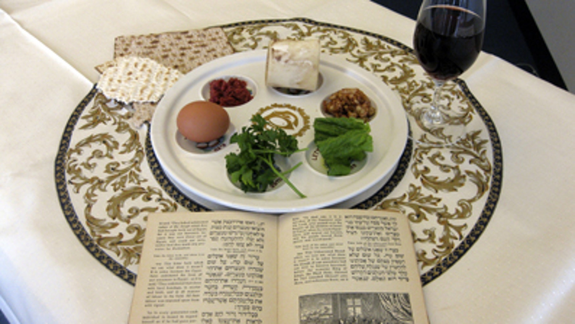 FILE: March 15, 2011: A 1936 Maxwell House Haggadah alongside a Seder plate in New York.