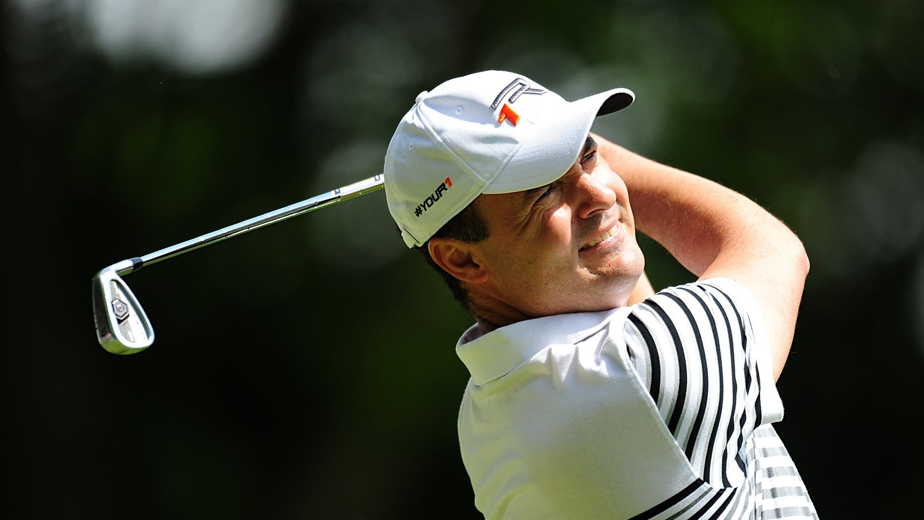 England's Simon Khan in action during round four on day four of the PGA Championship at the Wentworth Club, in Virginia Water, England, Sunday May 26, 2013. (AP Photo/Adam Davy, PA) UNITED KINGDOM OUT - NO SALES - NO ARCHIVES