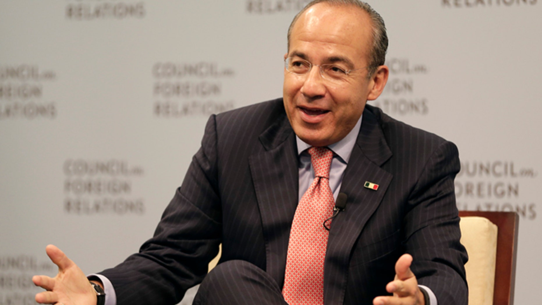 Mexican President Felipe Calderon answers a questions after speaking at the Council on Foreign Relations in Washington, Monday, Sept. 24, 2012. (AP Photo/Jacquelyn Martin)