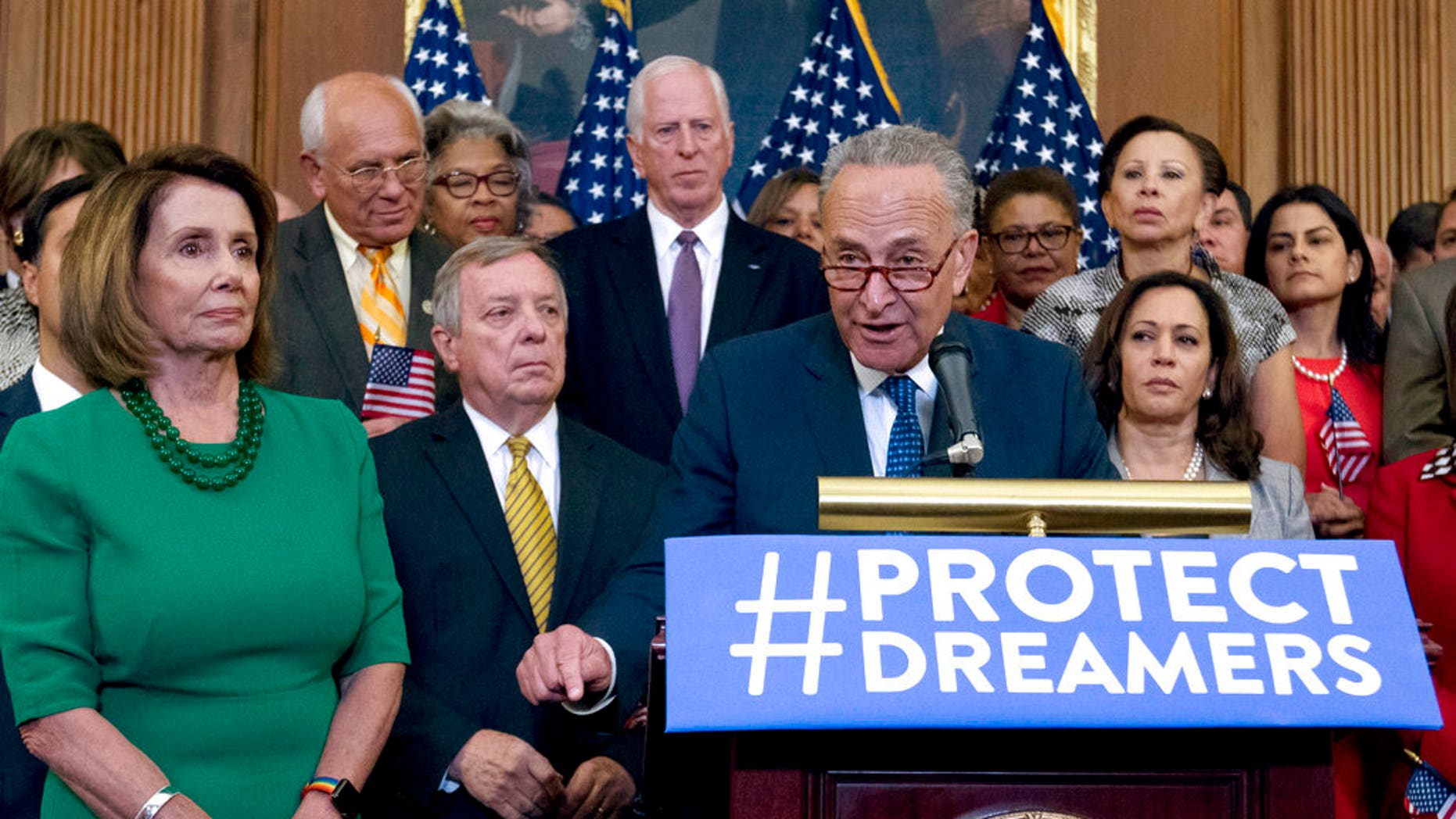 FILE - In this Sept. 6, 2017 file photo, Senate Minority Leader Chuck Schumer of N.Y., accompanied by House Minority Leader Nancy Pelosi of Calif., left, and others members of the House and Senate Democrats, speaks during a news conference on Capitol Hill in Washington.   It's beginning to look like Congress' election-year battle over immigration could end up in stalemate or a narrowly focused bill. The kind of broader measure that President Donald Trump has proposed is running into trouble. The reasons: Deep gaps between the two parties, internal divisions particularly among Republicans and political incentives that might leave each side content with a minimal compromise or even nothing at all. ( AP Photo/Jose Luis Magana)
