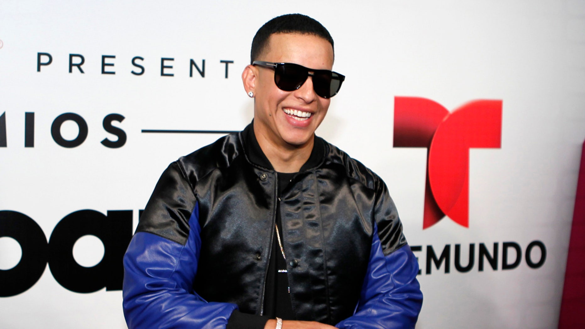 Daddy Yankee poses backstage at the 2015 Latin Billboard Awards in Coral Gables, Florida April 30, 2015.