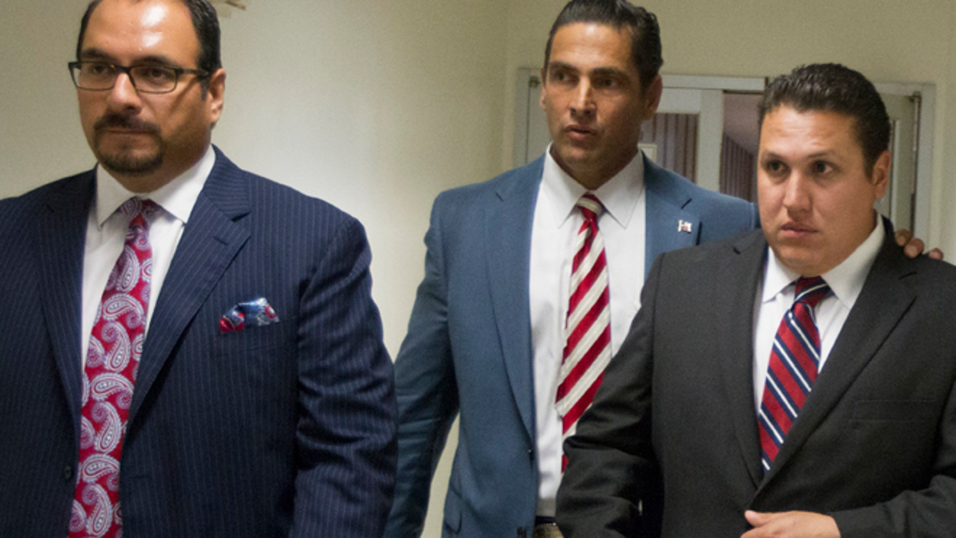 Aug. 27: David Barajas, right, walks through the hallway with his attorneys Sam Cammack, center, and Phil Morin as the jury deliberates at the Brazoria County Courthouse.