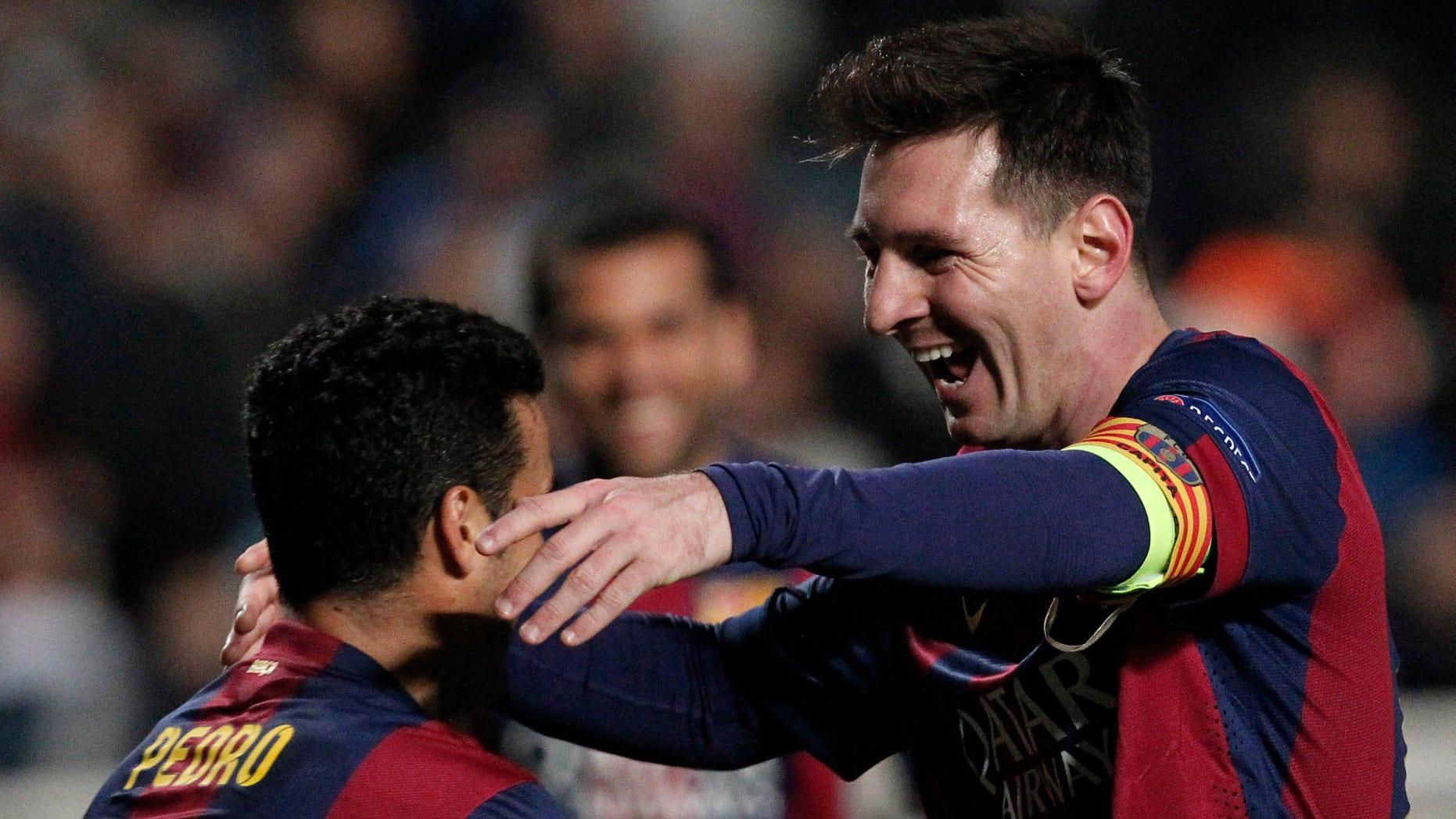 Messi celebrates with teammates scoring his side's 4th goal in Nicosia, Cyprus, Tuesday, Nov. 25, 2014.