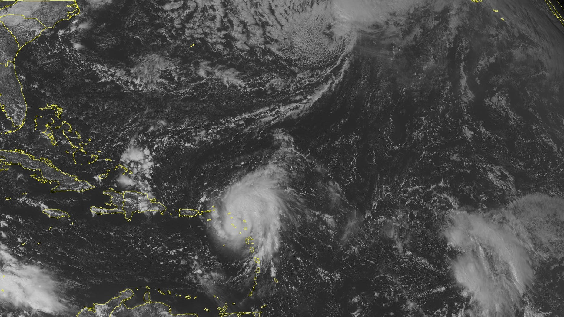 This NOAA satellite image taken Monday, October 13, 2014 at 10:45 AM EDT shows Tropical Storm Gonzalo 65 miles southeast of the island of Saint Thomas. This storm has maximum winds of 70 miles per hour and is moving northwest at 10 miles per hour. Gonzalo is expected to strengthen into a Hurricane in the coming hours and cross Puerto Rico before turning northward. Further north, Tropical Storm Fay is racing into the central Atlantic and will become post tropical. (AP PHOTO/WEATHER UNDERGROUND)