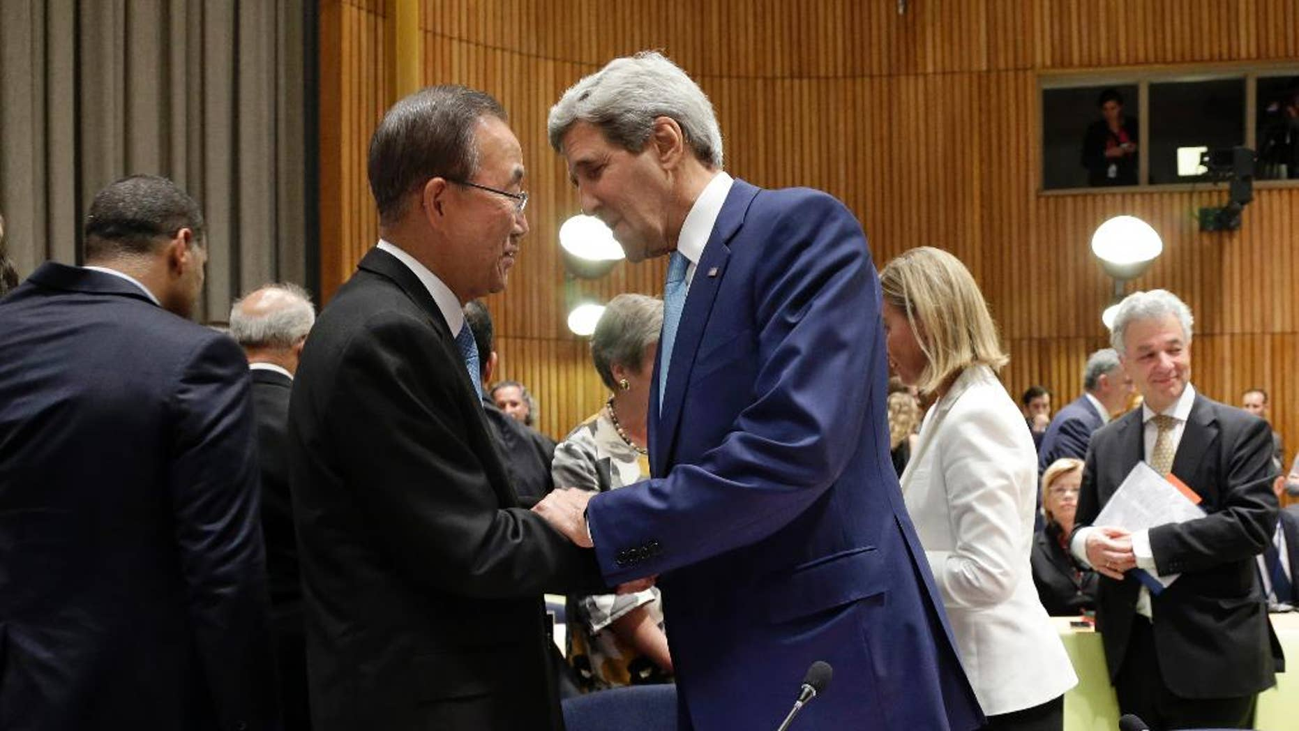 United Nations Secretary General Ban Ki-moon, left, greets U.S. Secretary of State John Kerry before the seventh Ministerial Meeting of the Comprehensive Nuclear-Test-Ban Treaty (CTBT) during the 69th session of the United Nations General Assembly at U.N. headquarters on Friday, Sept. 26, 2014. The meeting was co-organized by Australia, Canada, Finland, Germany, Japan and the Netherlands. (AP Photo/Pool, Jason Szenes)