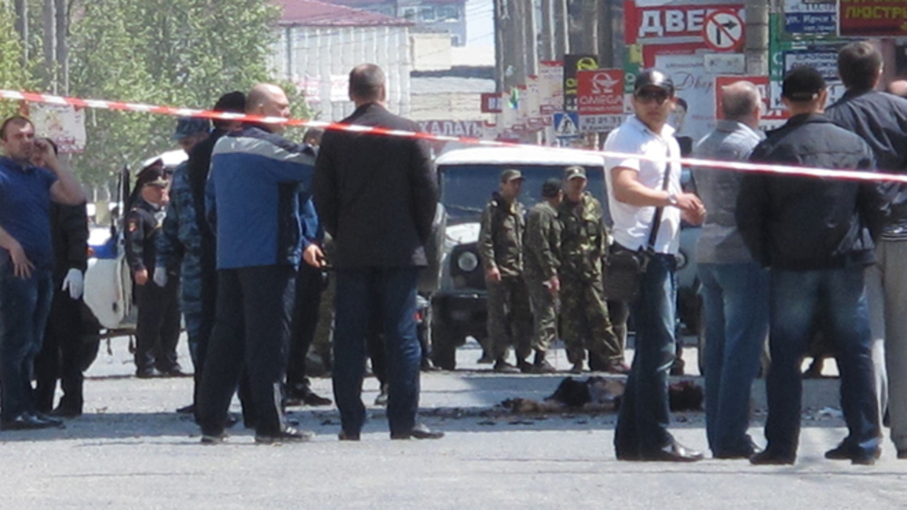 May 1, 2013: Police and forensic experts examine the site of an explosion in downtown Makhachkala, Dagestan. Russian police say a bomb  exploded in a busy shopping area in the capital of the restive republic of Dagestan, killing at least two people. Dagestan is plagued by Islamic insurgents who frequently mount small attacks on police.