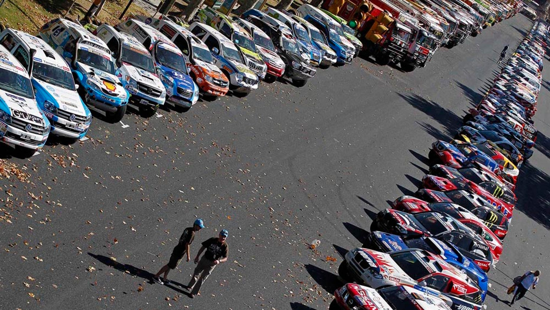 Vehicles are seen parked prior to the 2011 Argentina-Chile Dakar Rally in Buenos Aires, Argentina, Friday, Dec. 31, 2010. The rally will start on Jan. 1.  (AP Photo/Francois Flamand, Pool)