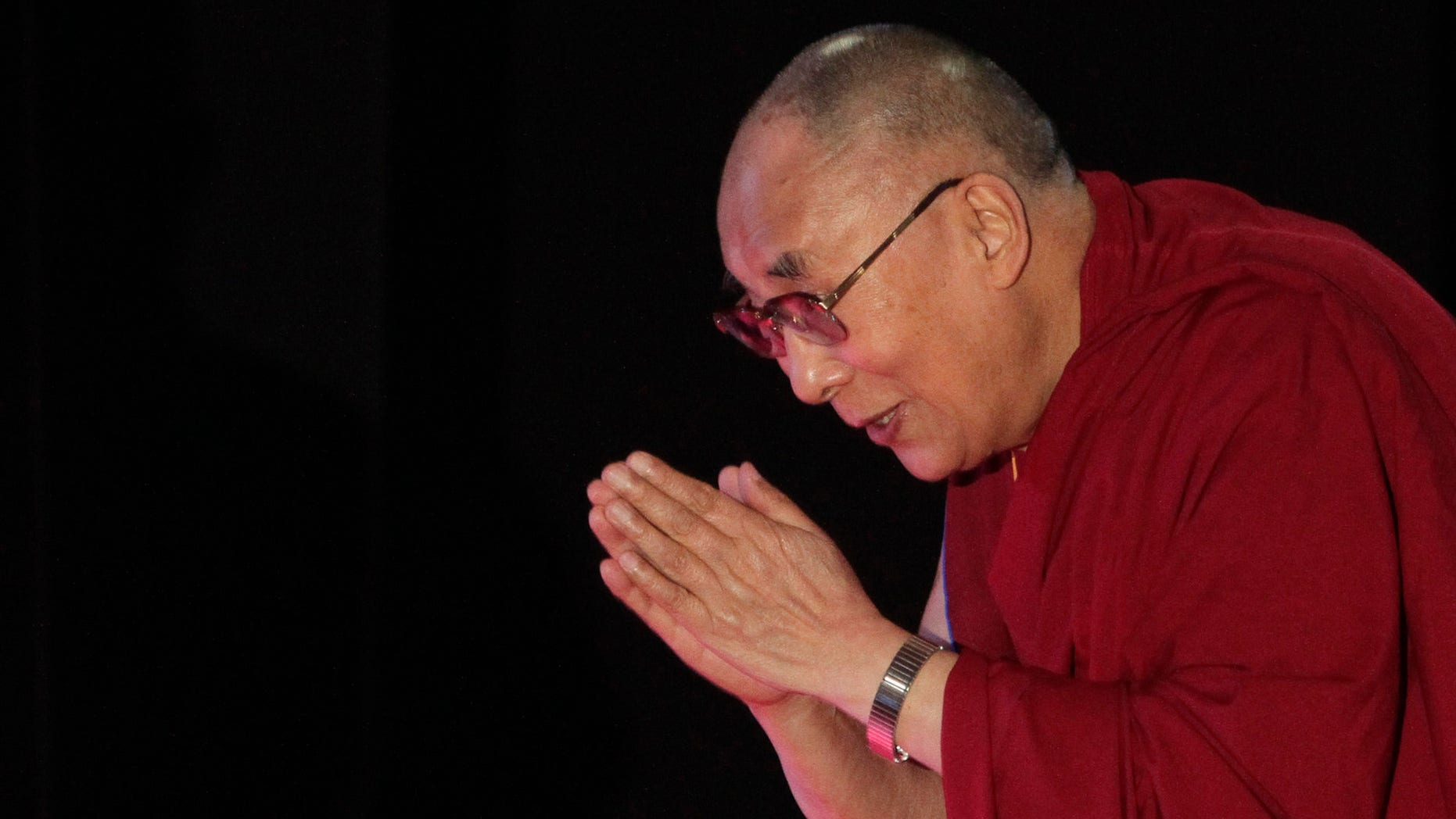 """Jan. 13, 2015: Tibetan spiritual leader the Dalai Lama greets the audience as he arrives to speak on """"A Human Approach to World Peace"""" at Presidency College in Kolkata, India."""