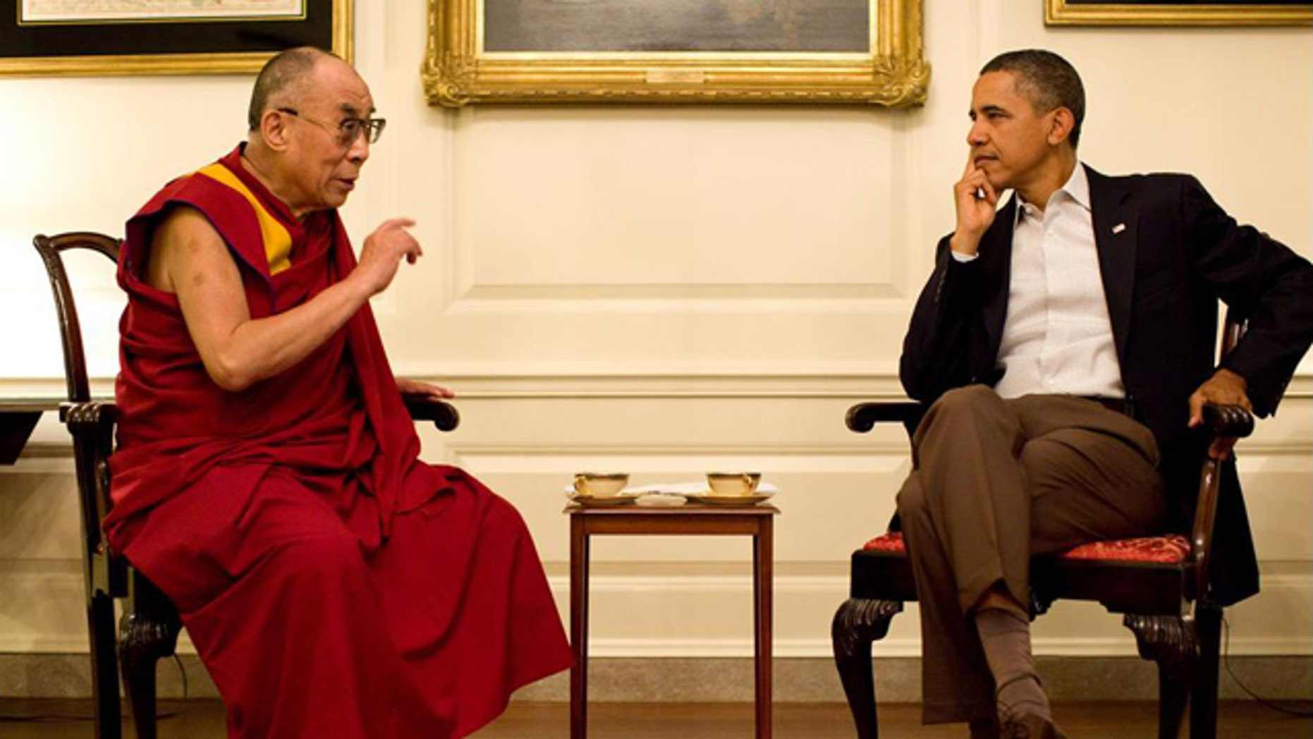 July 16: President Barack Obama meets with His Holiness the XIV Dalai Lama in the Map Room of the White House.