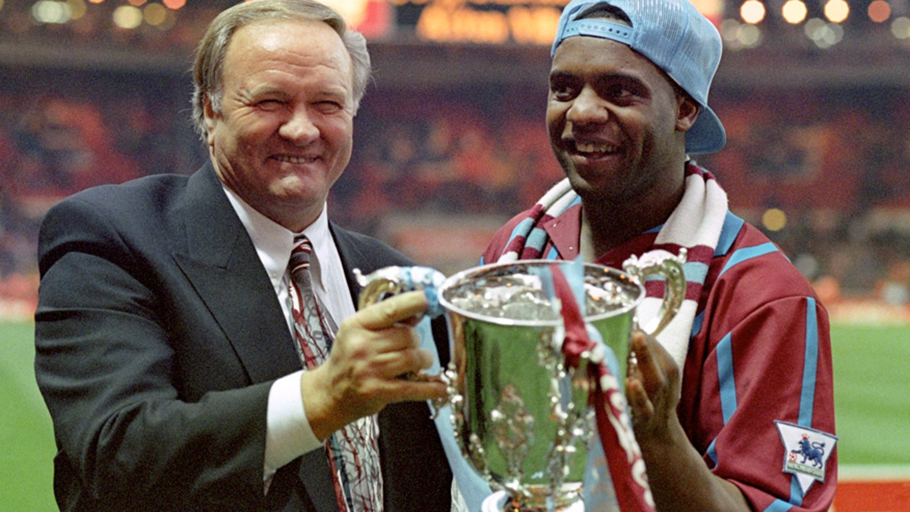March 27, 1994: Aston Villa manager Ron Atkinson holding the English League Cup with former Aston Villa player Dalian Atkinson at Wembley Stadium in London.