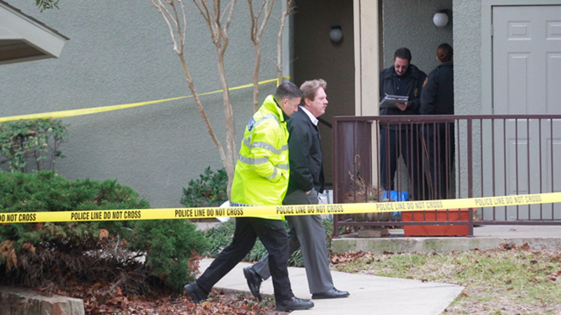 Dec. 25, 2011: Grapevine police investigate the scene where they found seven people dead outside Dallas in Grapevine, Texas.