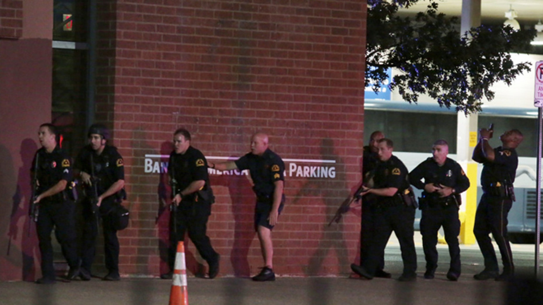 The sniper is believed to have fired from a downtown parking garage.